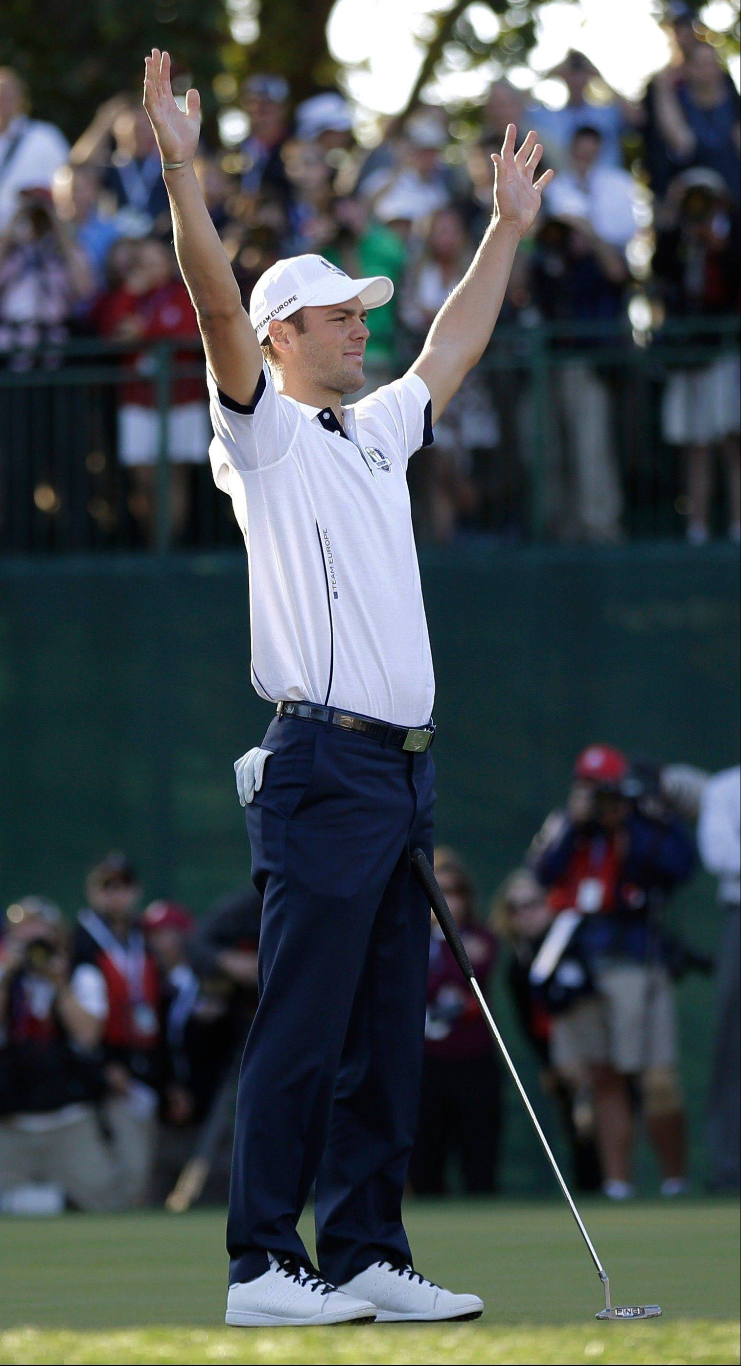 Europe's Martin Kaymer reacts after winning his match on the 18th hole to clinch a Europe win Sunday at the Ryder Cup.