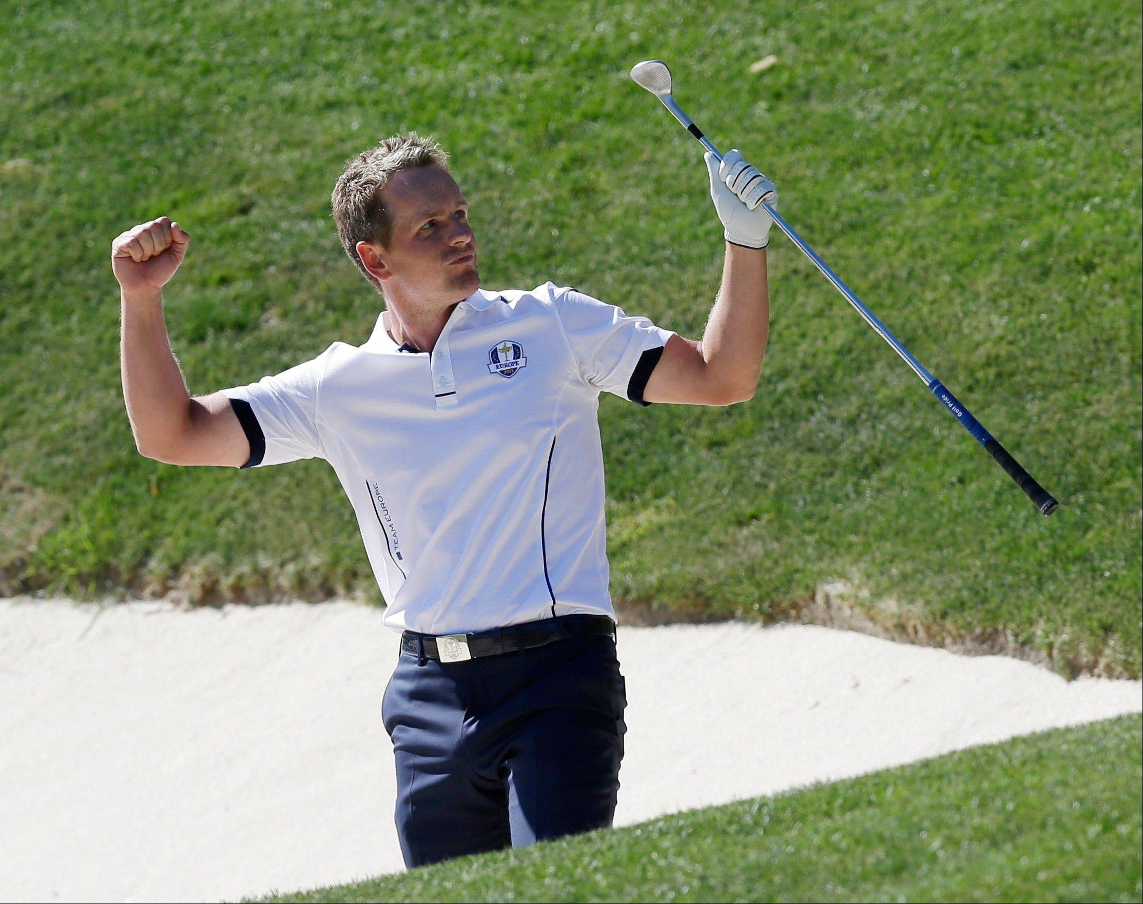 Europe's Luke Donald reacts after hitting out of a bunker on the 17th hole at Medinah Country Club Sunday. The hole gave Donald a win in the Ryder Cup match over USA's Bubba Watson.
