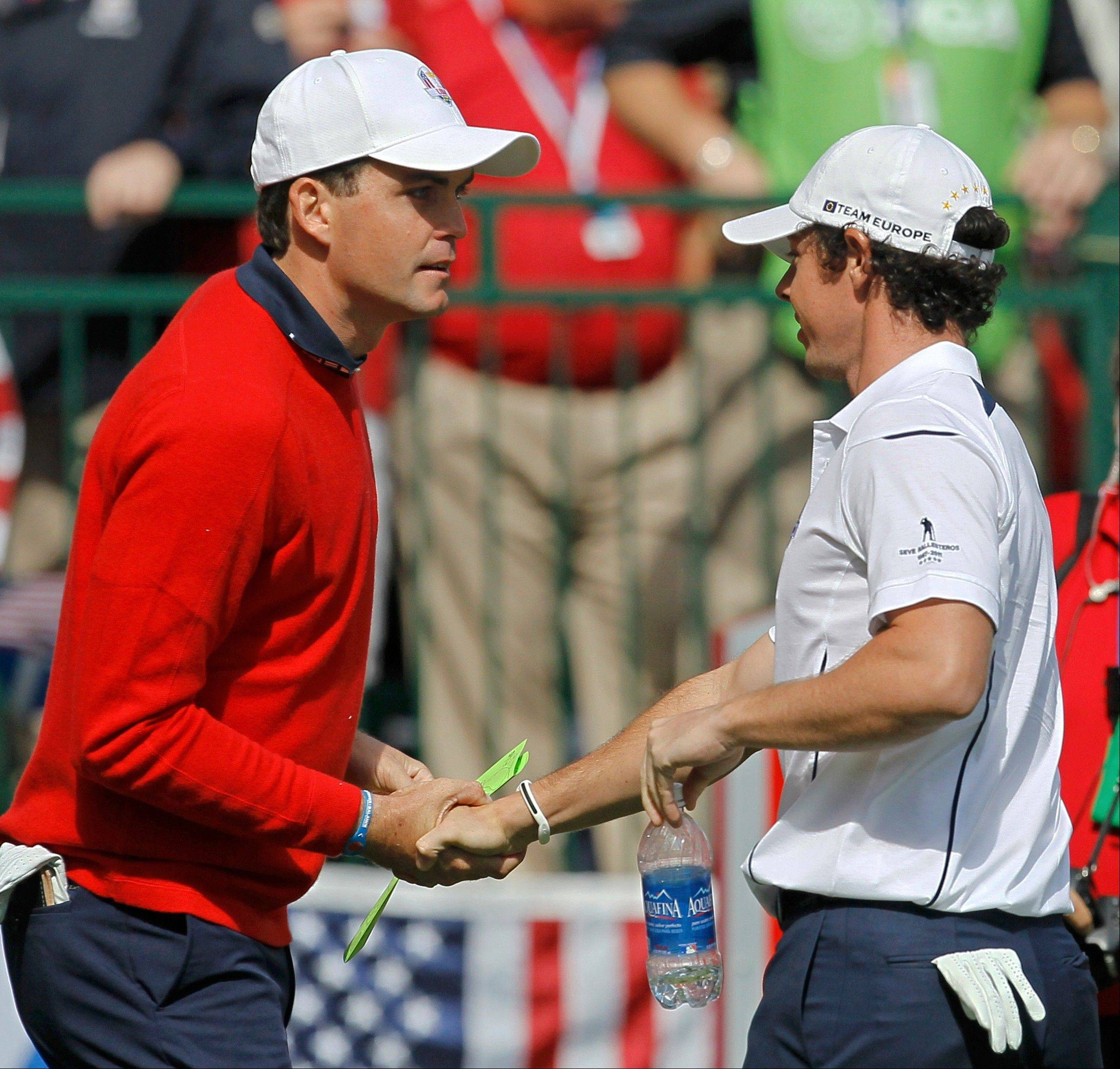 Europe's Rory McIlroy, right, shakes hands with USA's Keegan Bradley before a singles match at the Ryder Cup PGA golf tournament Sunday.
