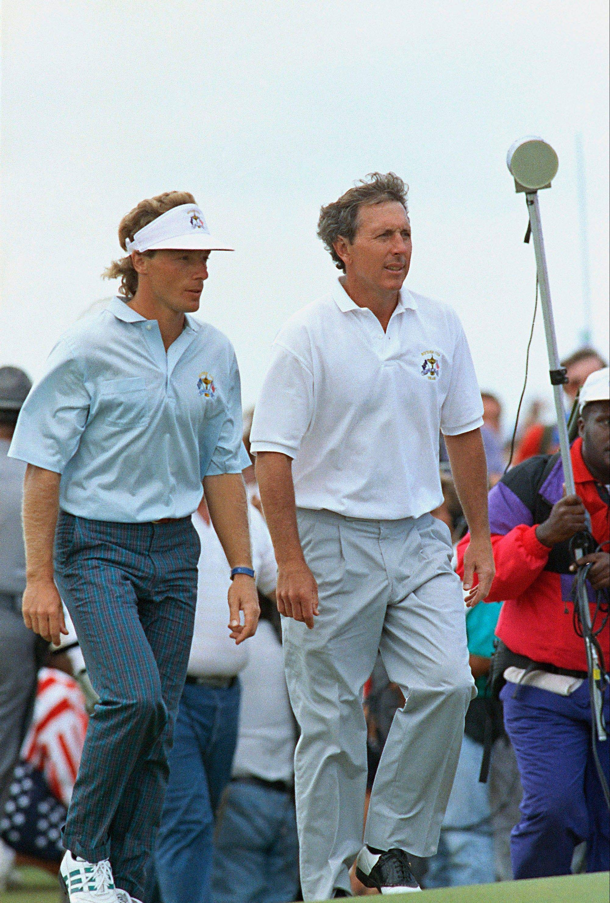 "Bernard Langer, left, a member of the European Ryder Cup team, and Hale Irwin, a member of the U.S. Ryder Cup team walk together on the 17th green during the deciding match of 1991 Ryder Cup, which became known as ""The War by the Shore."" The United States rallied to win the event at Kiawah Island, S.C., as Langer three-putted on the 18th green to split the final match."