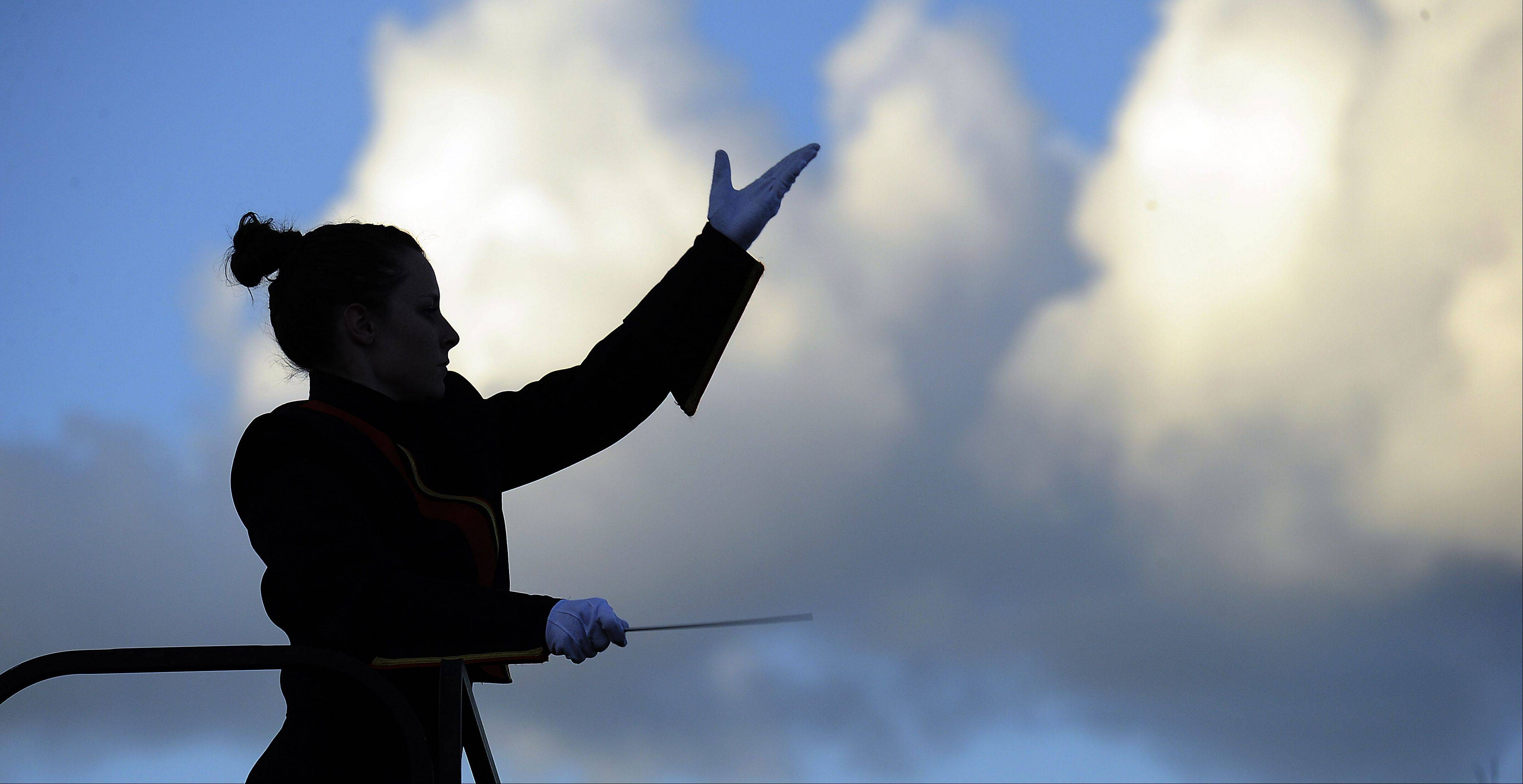 Mark Welsh/mwelsh@dailyherald.com Drum Major Maggie Inman directs the Wheaton Warrenville South High School marching band's song selection of Class of Dreams at the Chicagoland Marching Band Festival at Wheeling High School on Saturday.