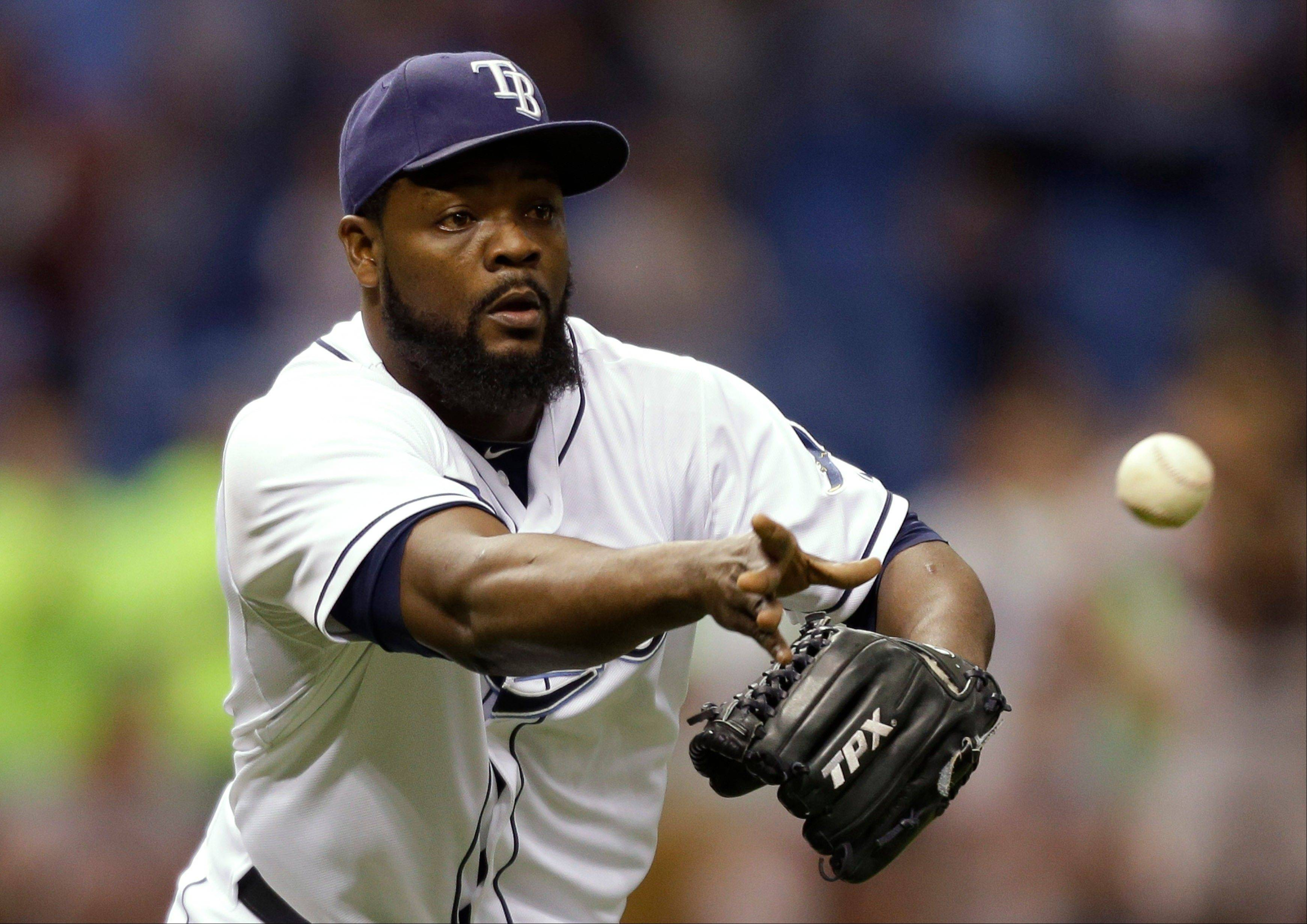 Rays relief pitcher Fernando Rodney flips the ball to first base to get Baltimore�s Endy Chavez and end the game Monday in St. Petersburg, Fla.