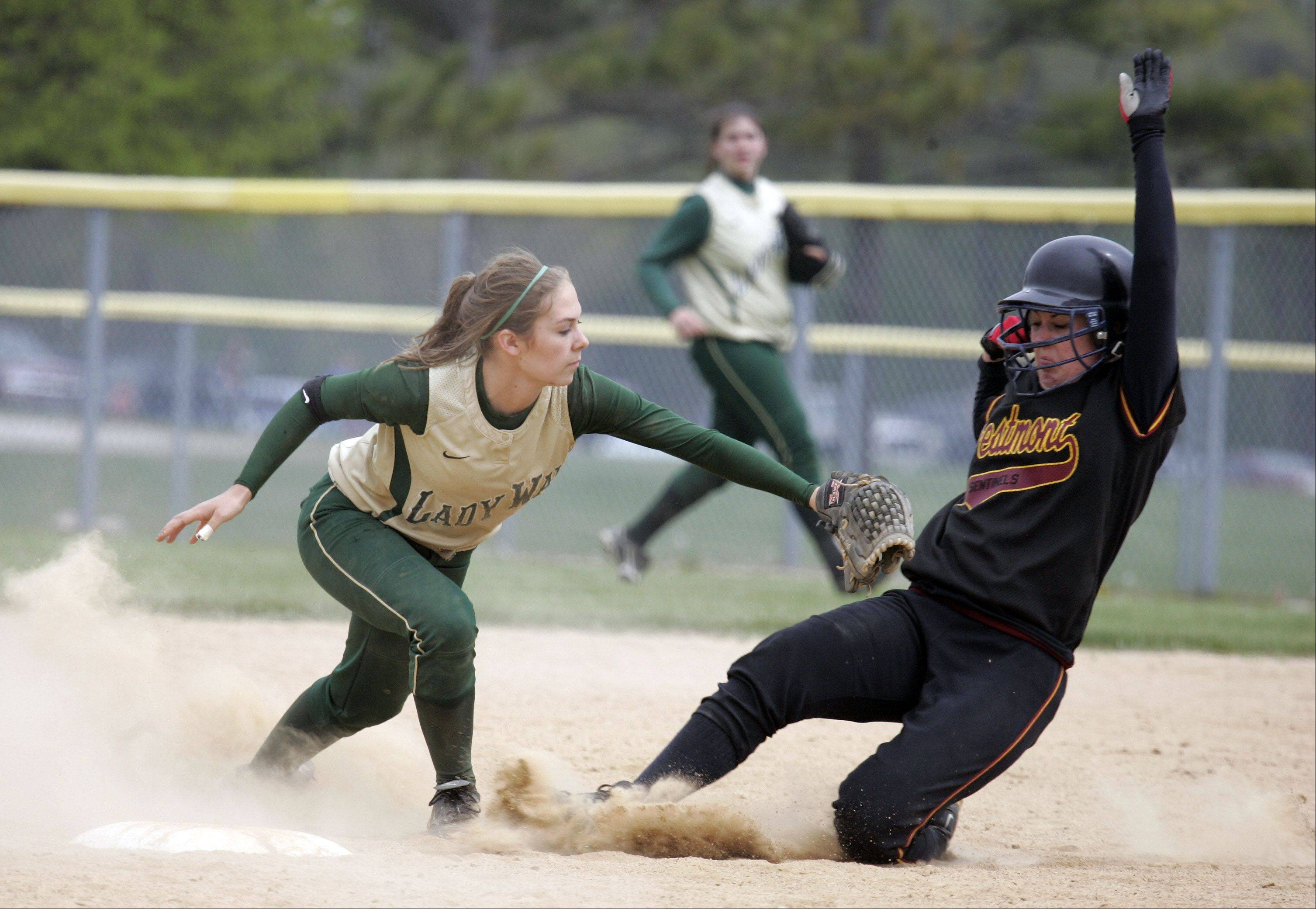 St. Edward shortstop Kali Kossakowski, left, has verbally committed to accept a softball scholarship from Northern Illinois University.