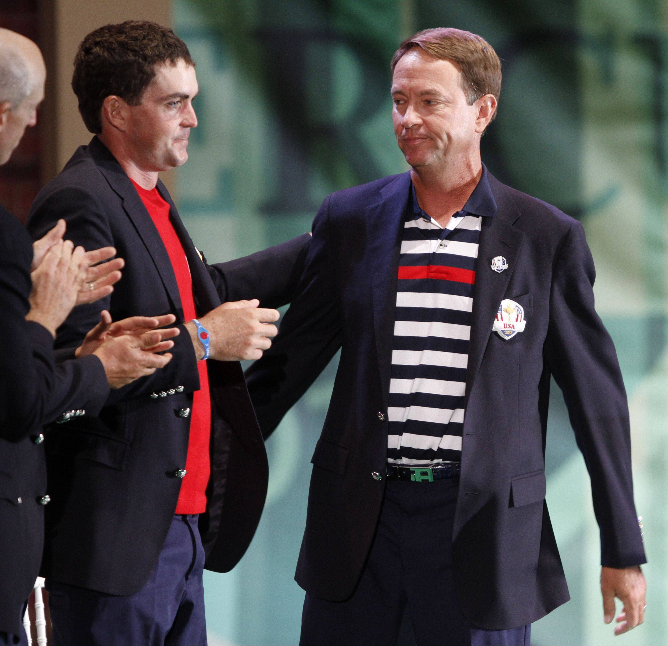 U.S. captain Davis Love III is applauded by his players including Jim Furyk, left, and rookie Keegan Bradley, after Love's remarks Sunday during the closing ceremony of the Ryder Cup.