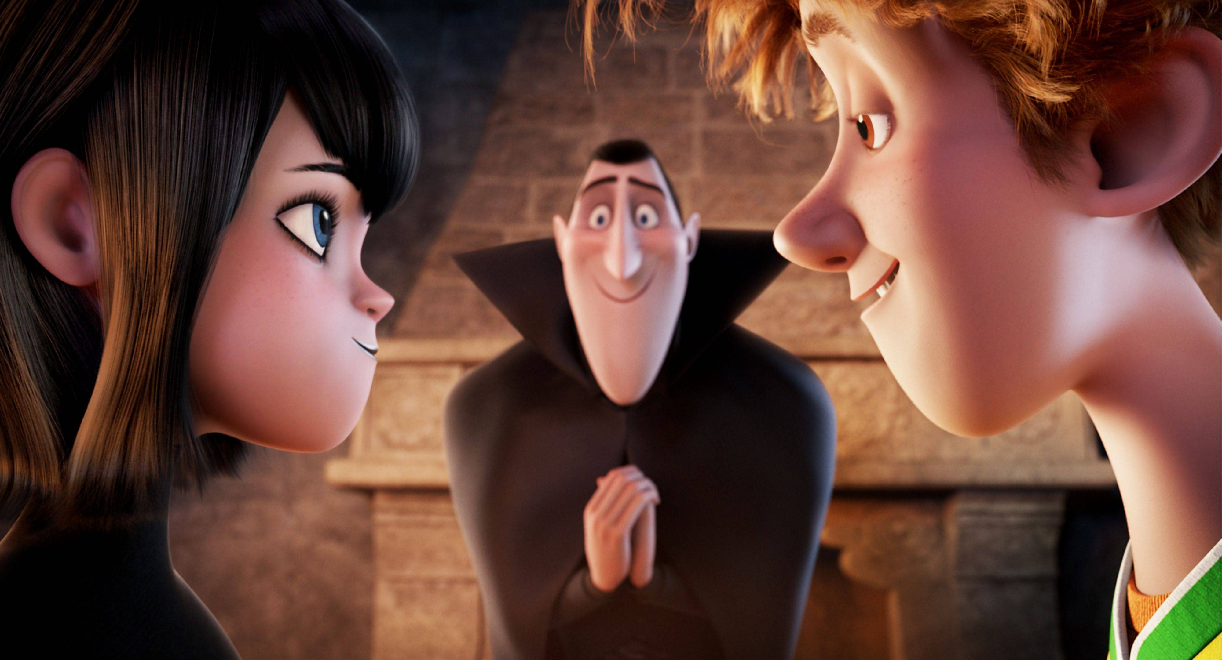 "Vampire Mavis (voiced by Selena Gomez) shares a ""zing"" with Jonathan (Andy Samberg) while Count Dracula (Adam Sandler) watches in ""Hotel Transylvania."""