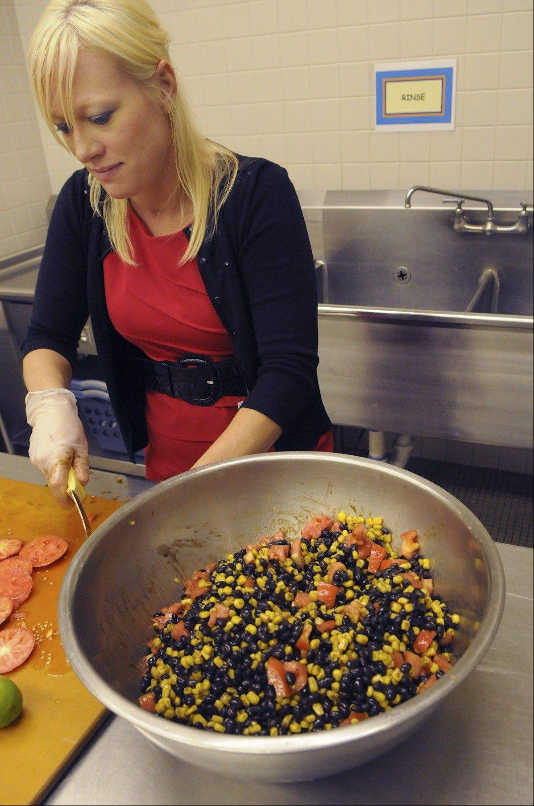 Jennifer Reiser mixes black bean corn salsa in the kitchen at Quaker Valley's Anthony Wayne Middle School.