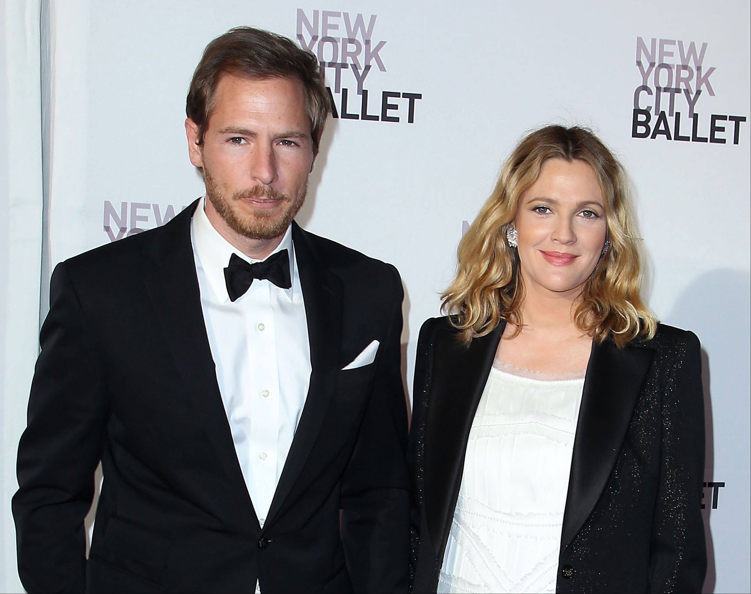 Will Kopelman, left, and Drew Barrymore are the parents of a baby girl named Olive Barrymore Kopelman born Sept. 26.