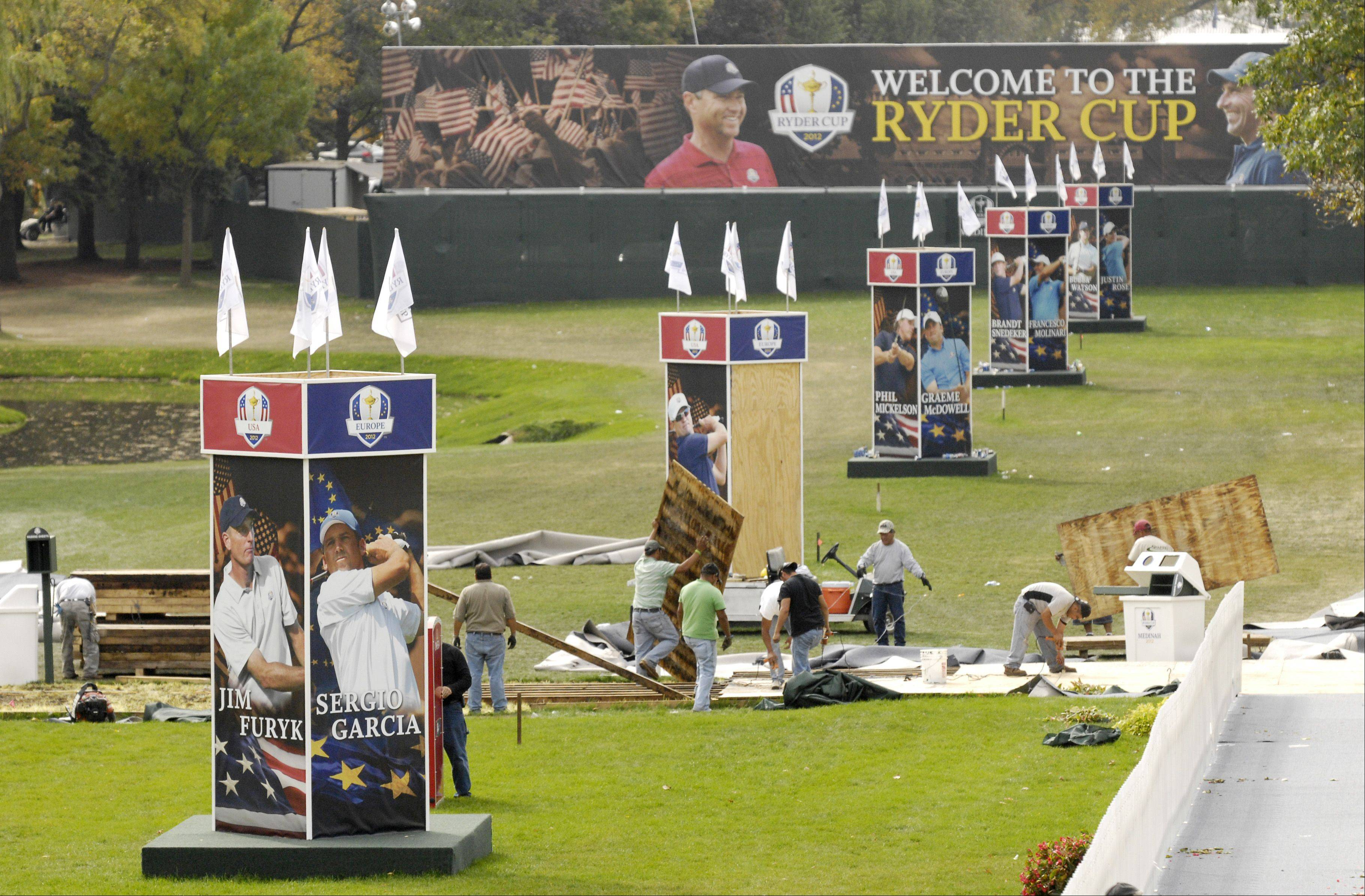 The spectator entrance ramps are dismantled in the wake of the 2012 Ryder Cup at Medinah.