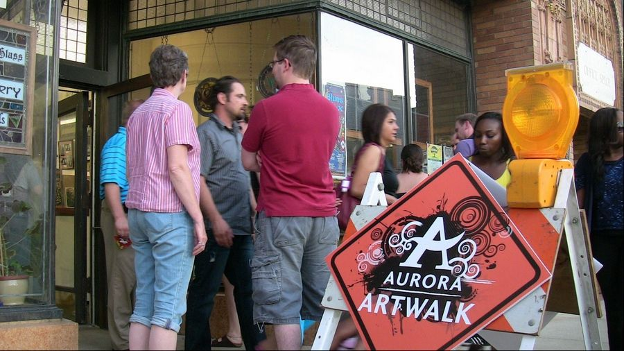 Crowds mingle outside a shop during a previous Aurora ArtWalk. The eighth ArtWalk will be held from 7 to 10 p.m. Friday, Oct. 5, at several locations along North Broadway Avenue.