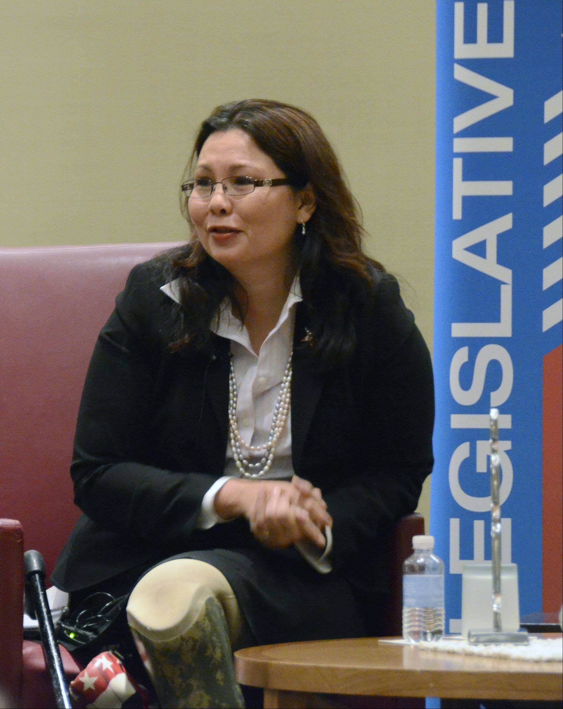 Tammy Duckworth of Hoffman Estates, Democratic challenger to Republican Congressman Joe Walsh of McHenry, speaks at a Schaumburg Business Association breakfast meeting Monday in Schaumburg.