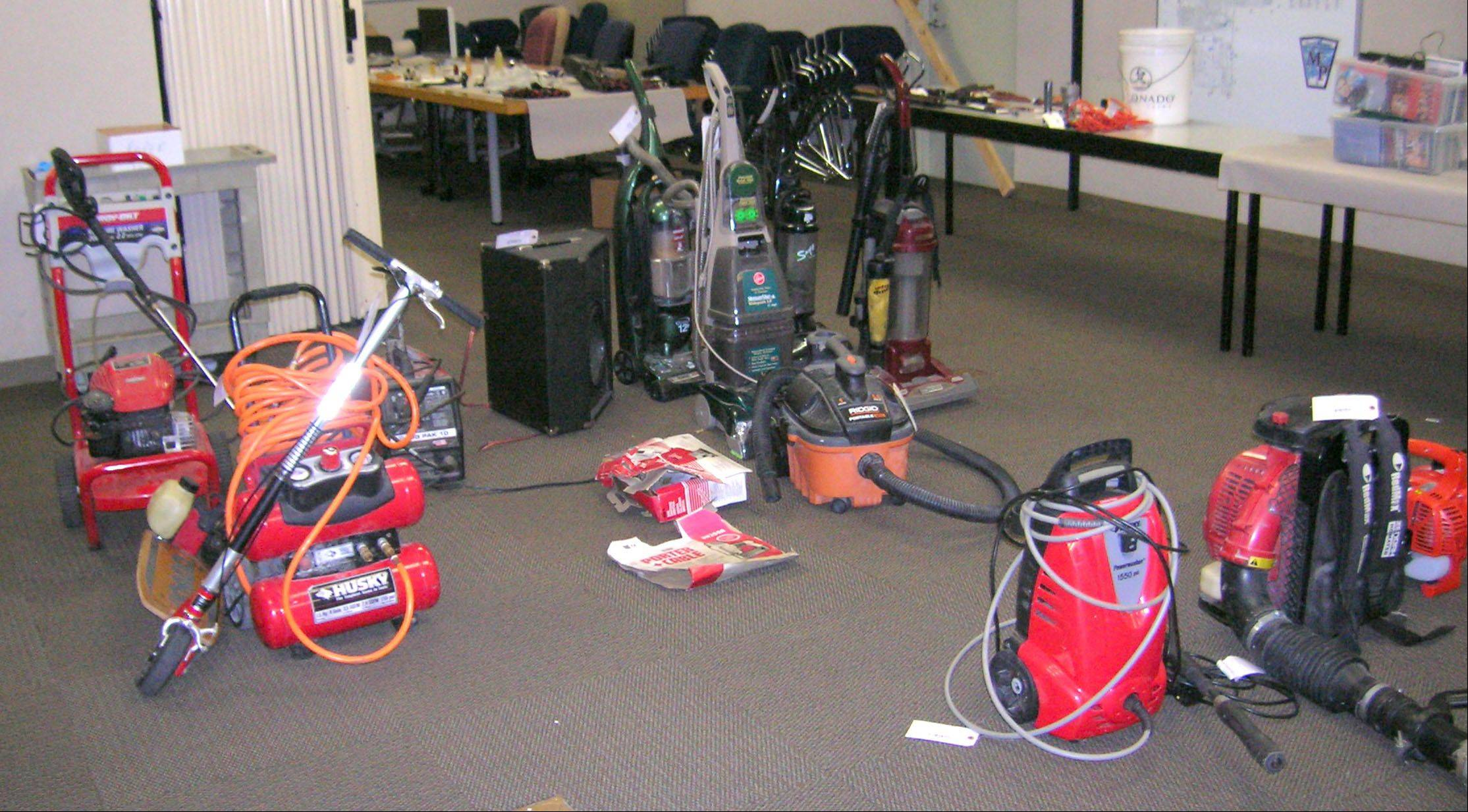 The Mount Prospect police training room is filled with stolen items recovered from a home where three residents were arrested Wednesday in connection with a string of 60 burglaries.