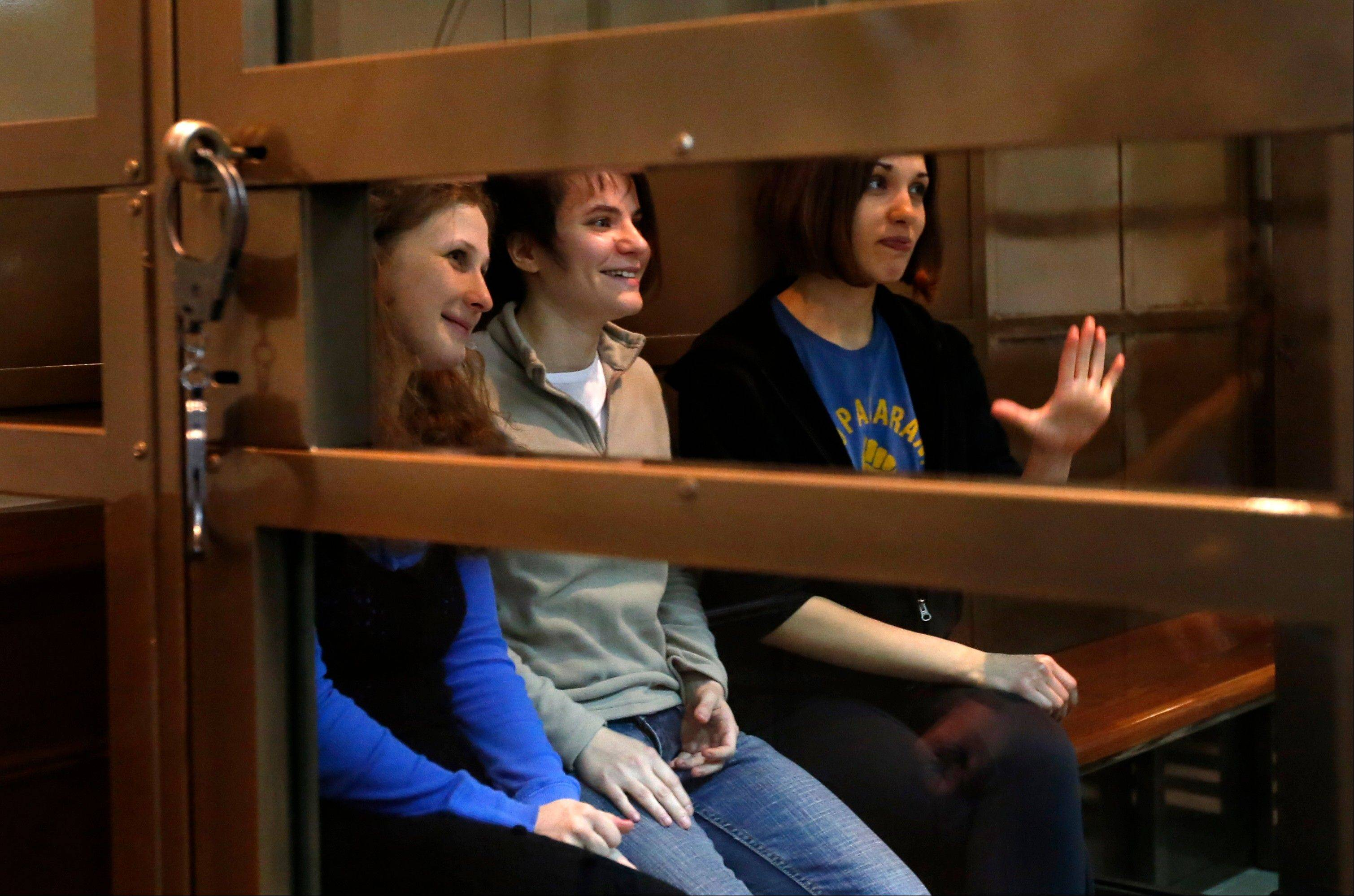 "Feminist punk group Pussy Riot members Maria Alekhina, left, Yekaterina Samutsevich and Nadezhda Tolokonnikova sit in a glass cage at a courtroom in Moscow, Russia, on Monday. A Russian court is set to hear an appeal filed by three jailed members of the rock band Pussy Riot, who have been sentenced to two years for performing a ""punk prayer"" against President Vladimir Putin at Moscow's main cathedral."