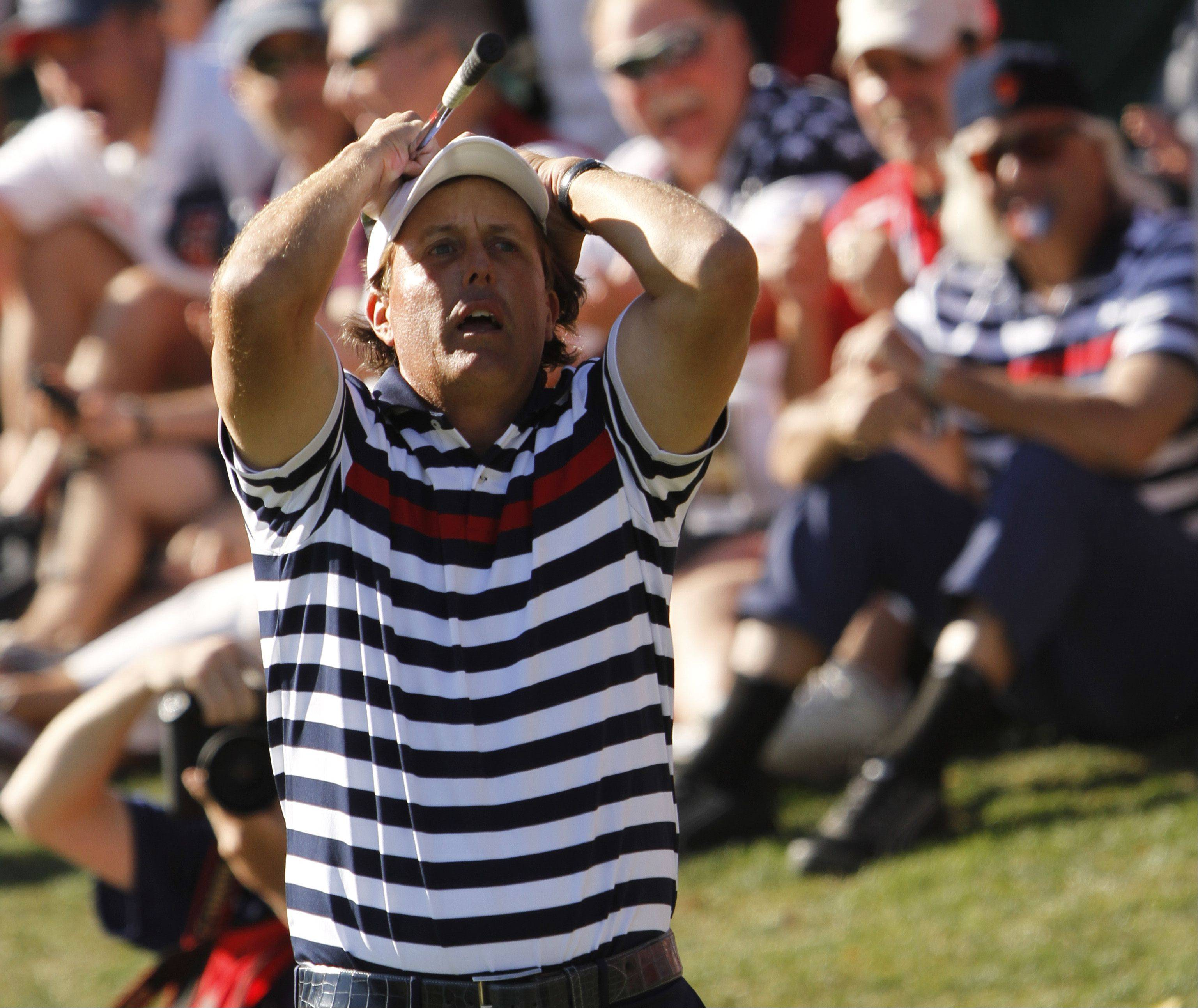 Phil Mickelson reacts after a bad chip on the 17th hole Sunday during the final day of the 2012 Ryder Cup at Medinah Country Club.