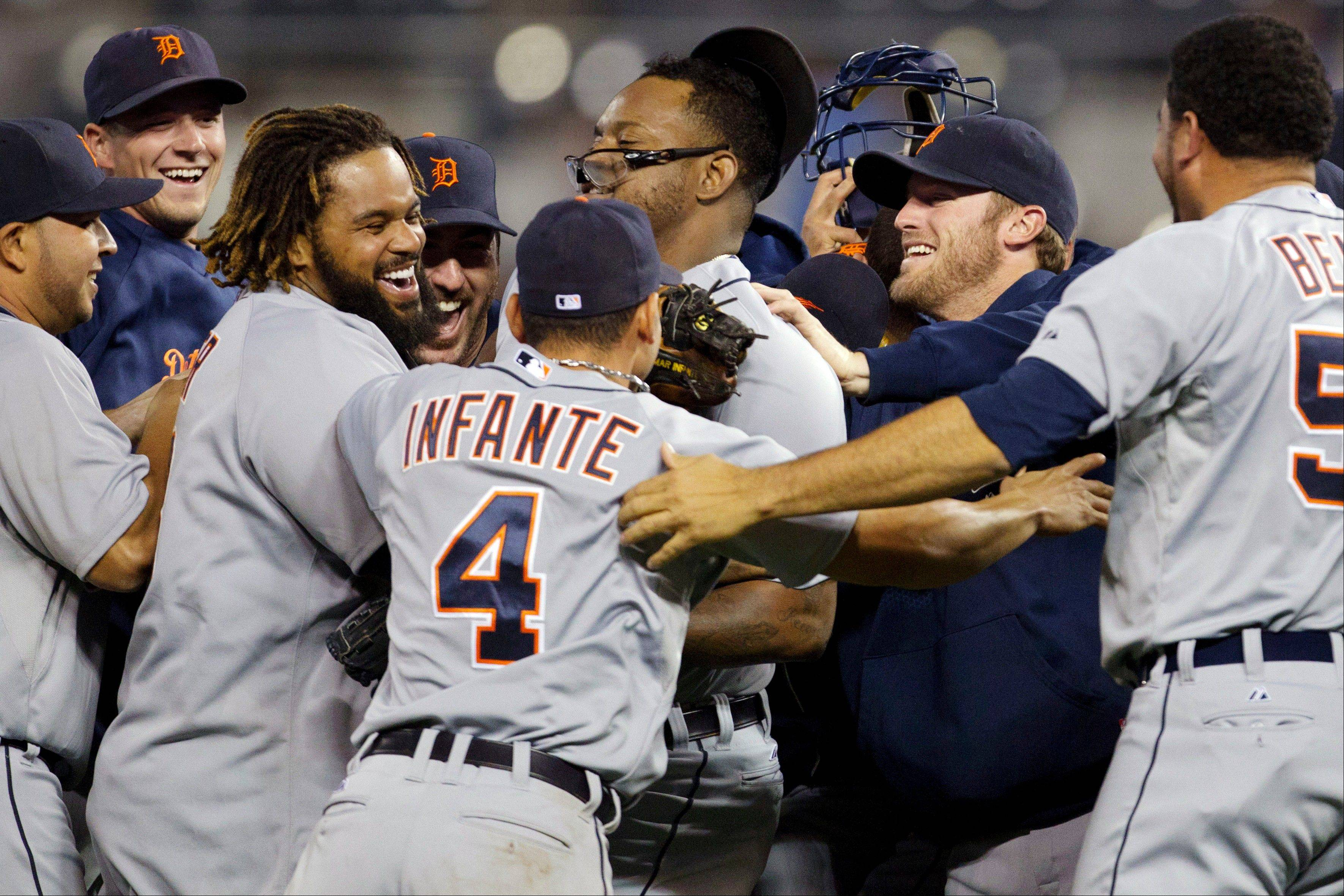 The Detroit Tigers celebrate their road win against the Kansas City Royals that clinched the AL Central crown on Monday.