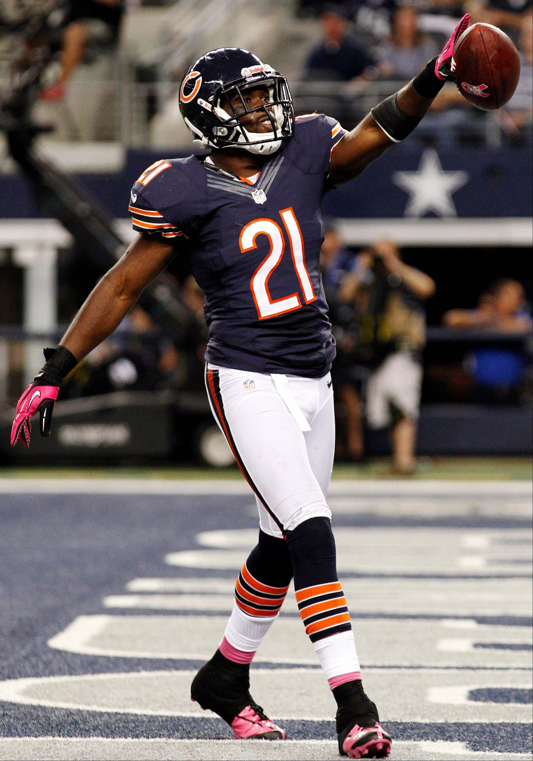 Bears strong safety Major Wright celebrates his interception against the Dallas Cowboys during the second half Monday in Arlington, Texas.