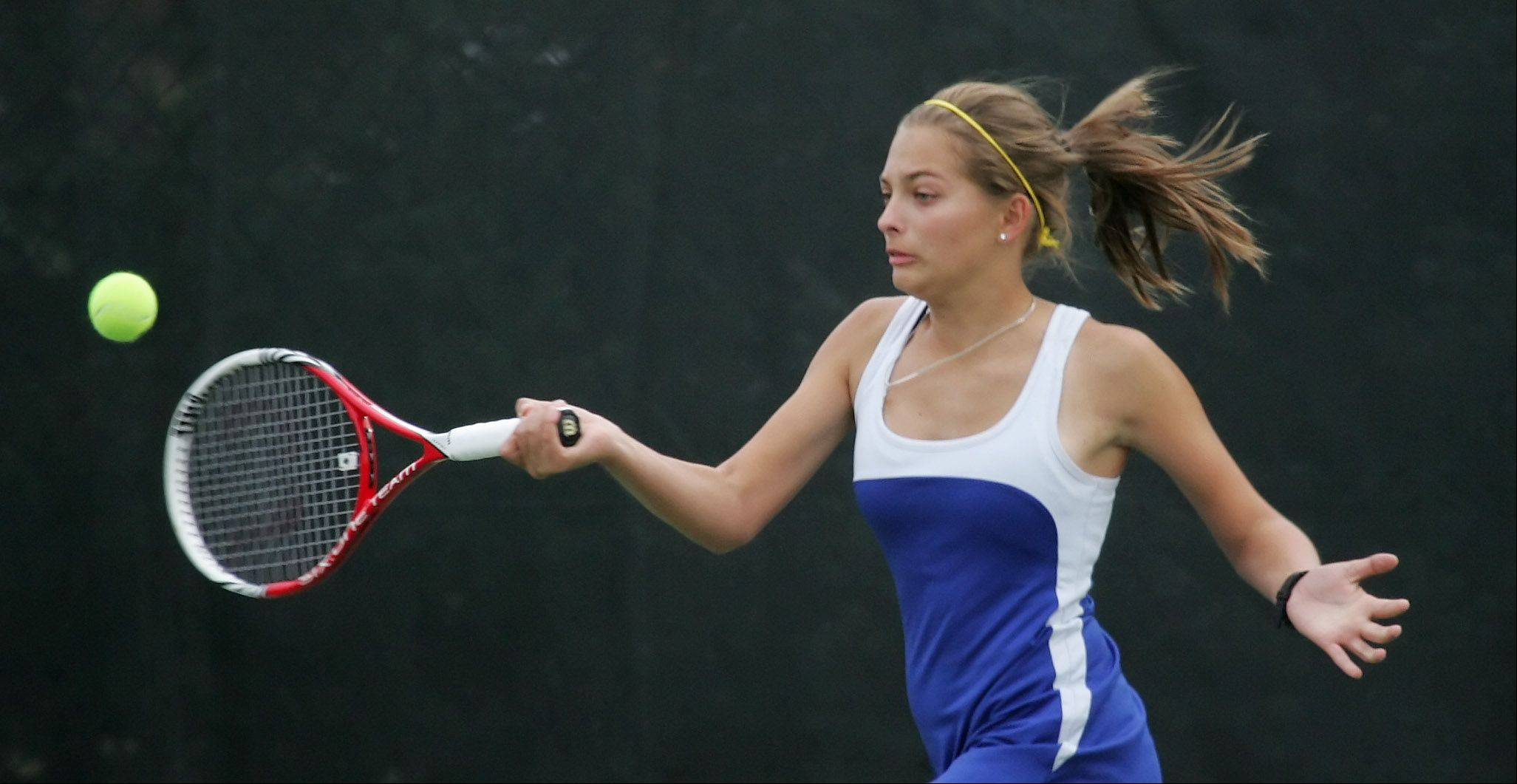 Warren singles player Karyna Bihel returns a shot against Carmel's Brienne Minor on Monday in Mundelein.