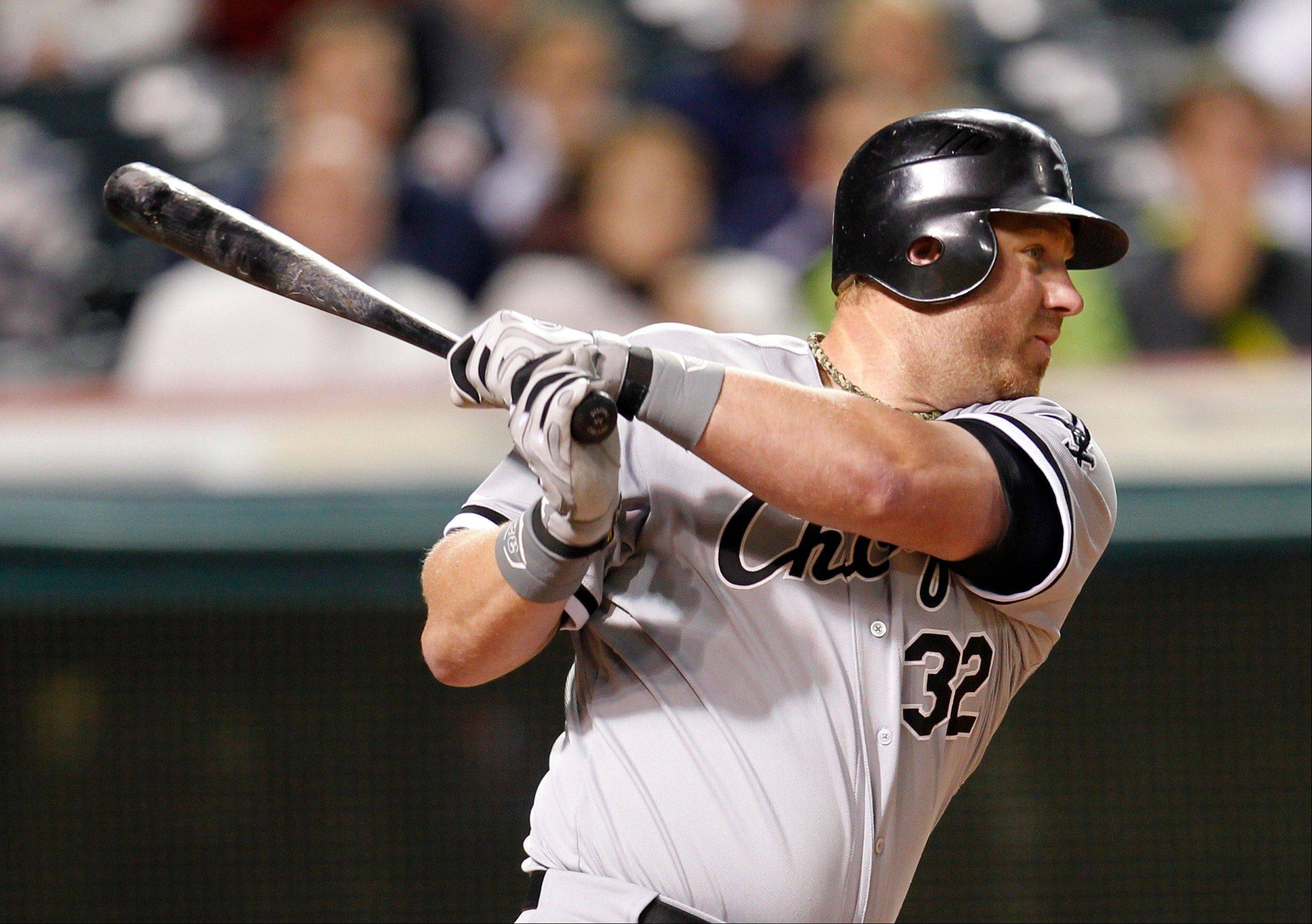 Adam Dunn (2-for-4) hits an RBI single in the sixth inning Monday in Cleveland. If Dunn strikes out three more times this season, he'll tie the record for most in a season (223).