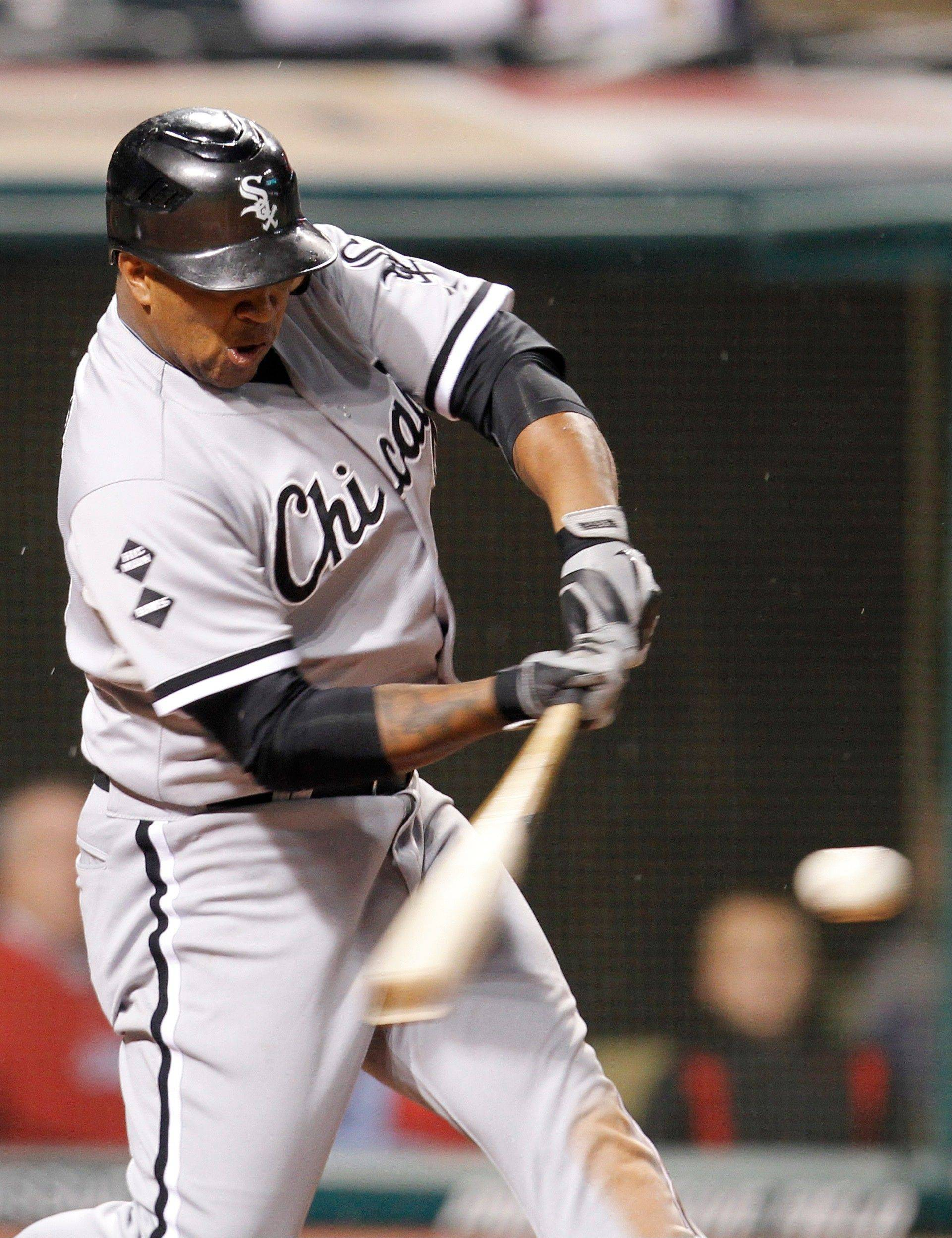 Dayan Viciedo hits a grand slam in the ninth inning of a baseball game against the Cleveland Indians, Monday, Oct. 1, 2012, in Cleveland. A.J. Pierzynski, Ray Olmedo and Jordan Danks scored. The White Sox won 11-0.