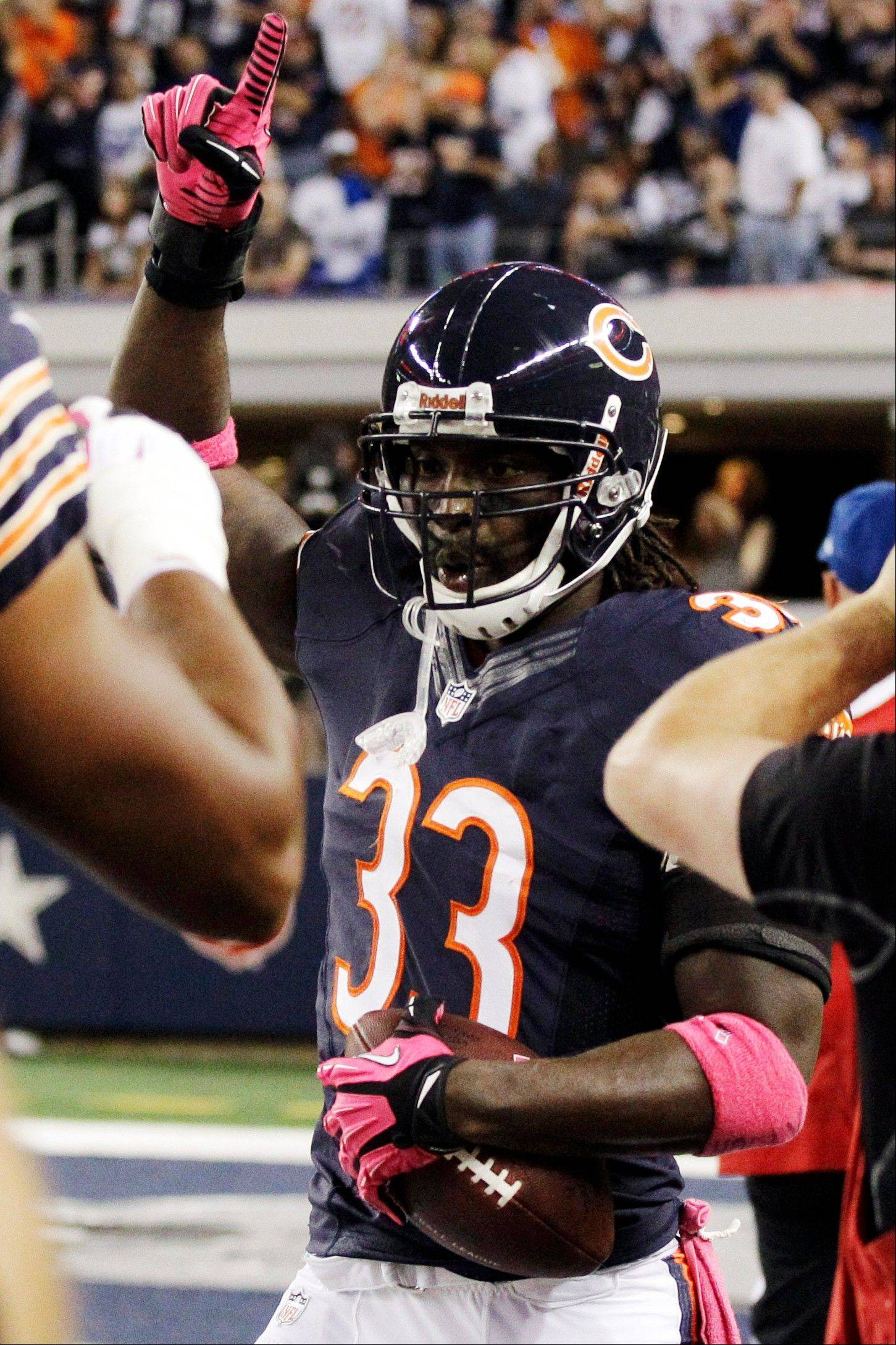 Chicago Bears cornerback Charles Tillman celebrates after returning an interception for a touchdown during the first half.