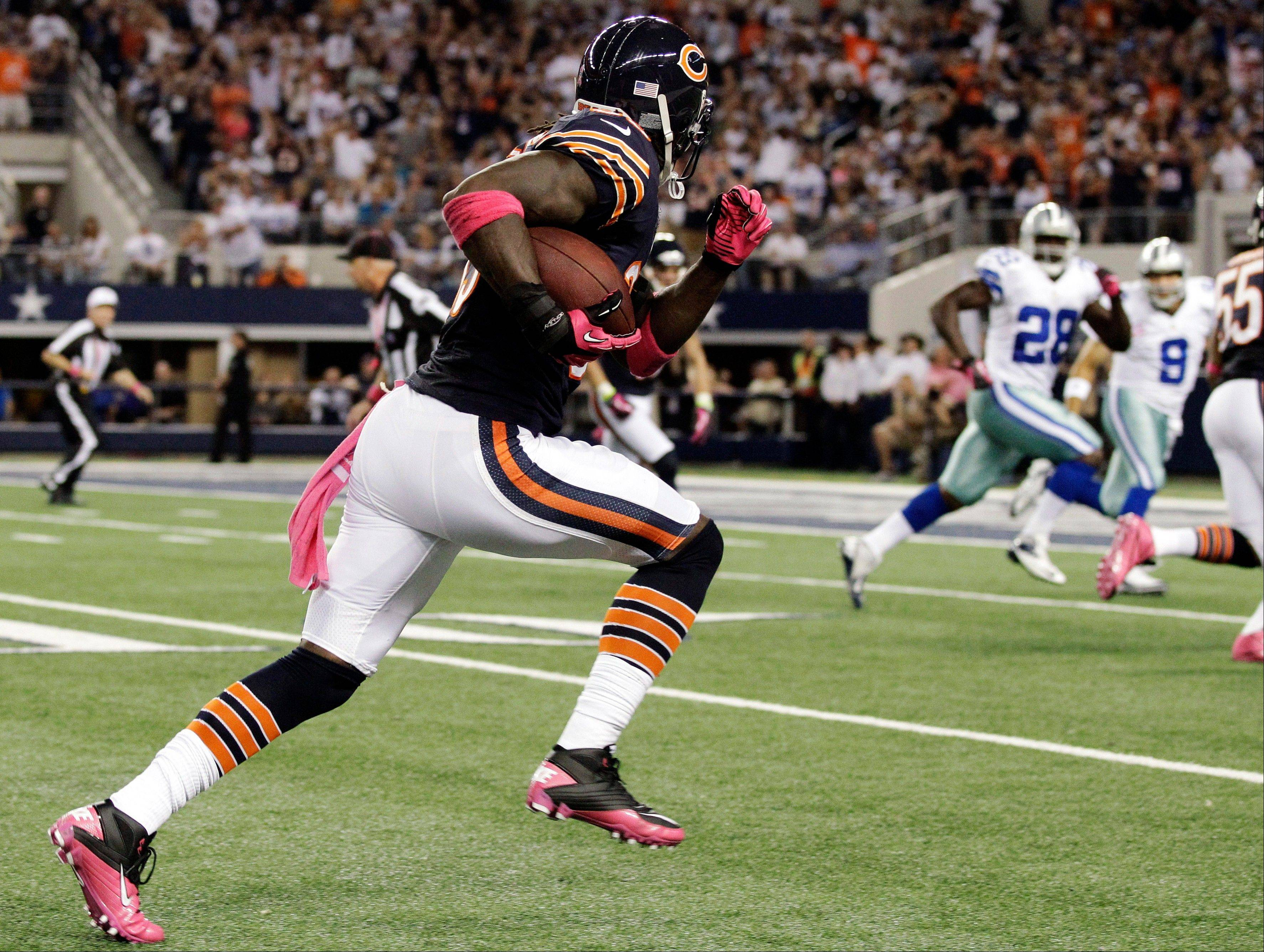 Chicago Bears cornerback Charles Tillman returns an interception for a touchdown during the first half.