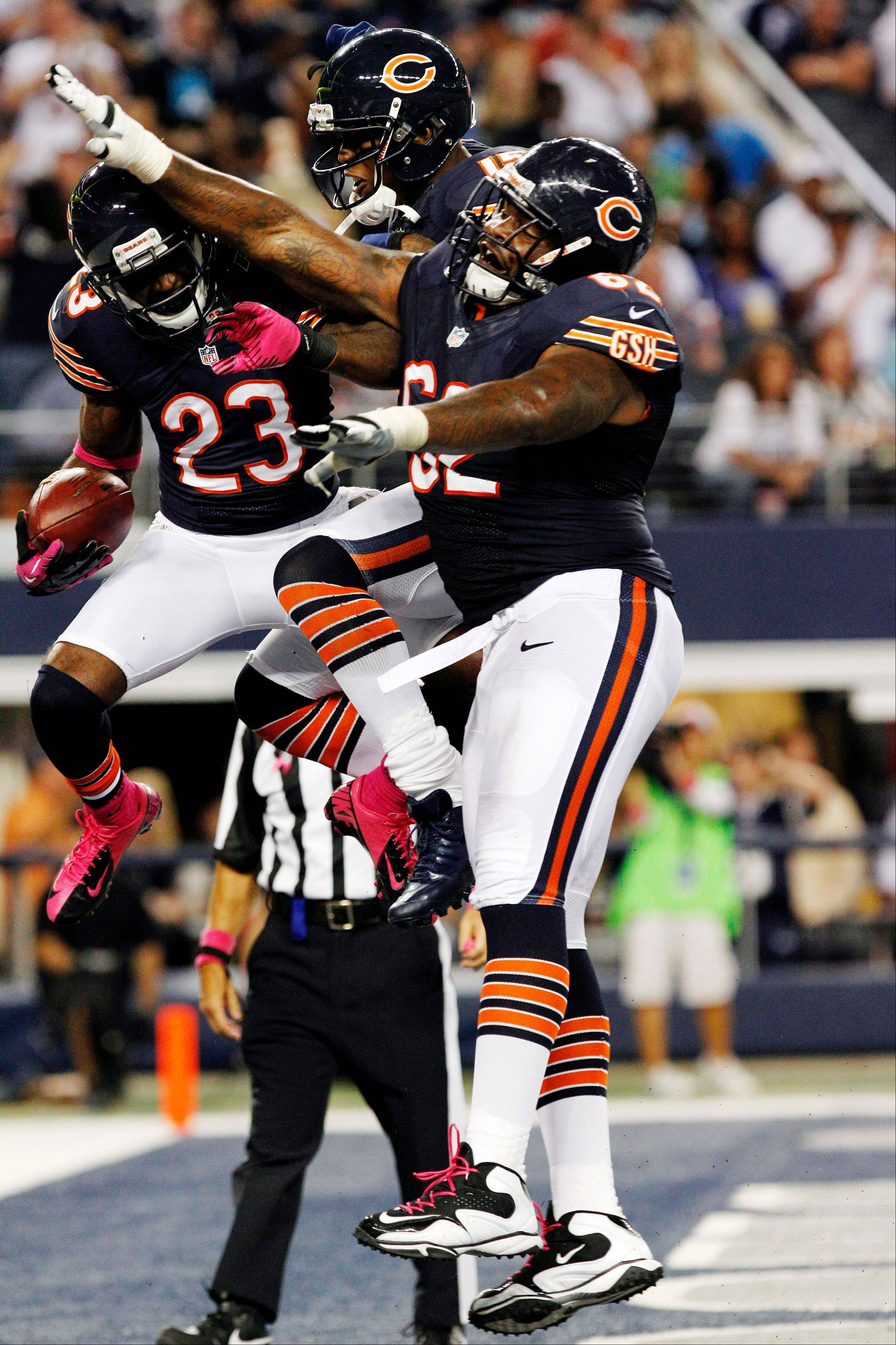 Chicago Bears wide receiver Devin Hester celebrates his touchdown against the Dallas Cowboys with Brandon Marshall and Chilo Rachal during the second half.