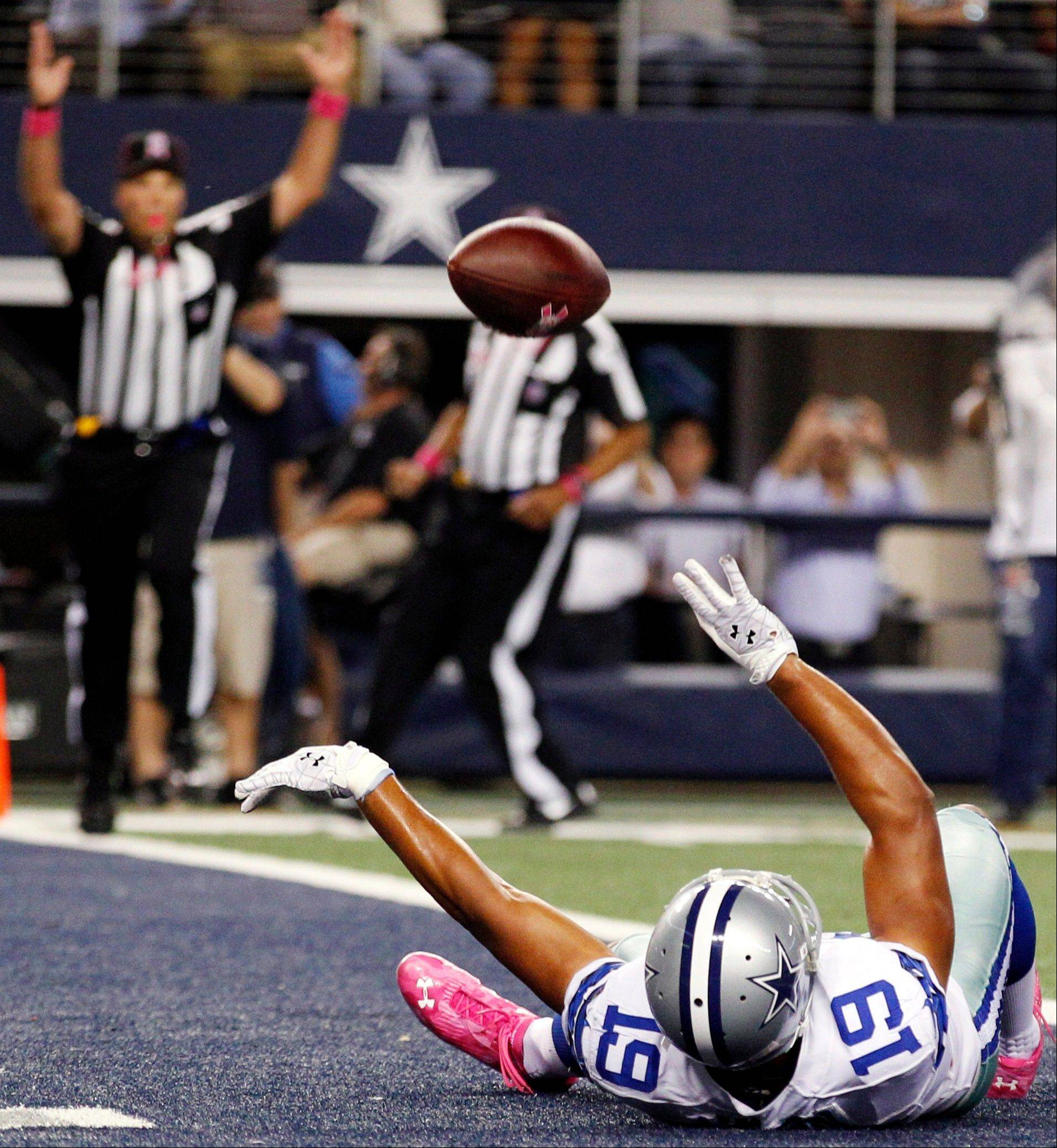 Dallas Cowboys wide receiver Miles Austin celebrates after scoring a touchdown against the Chicago Bears.