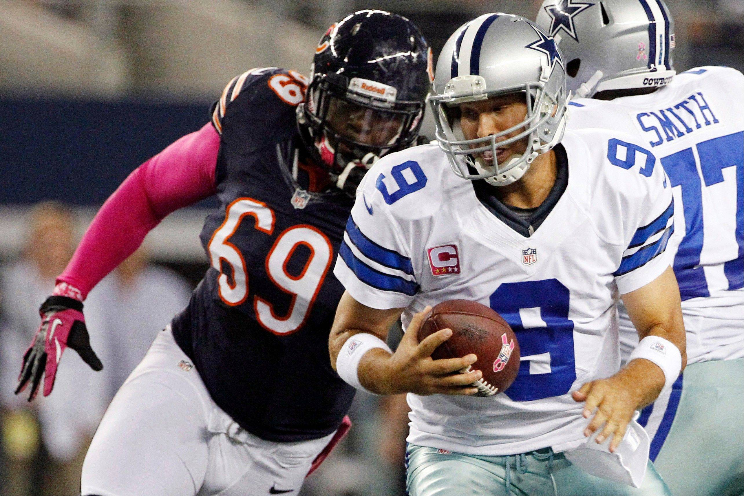 Chicago Bears defensive tackle Henry Melton moves in to sack Dallas Cowboys quarterback Tony Romo during the first half.