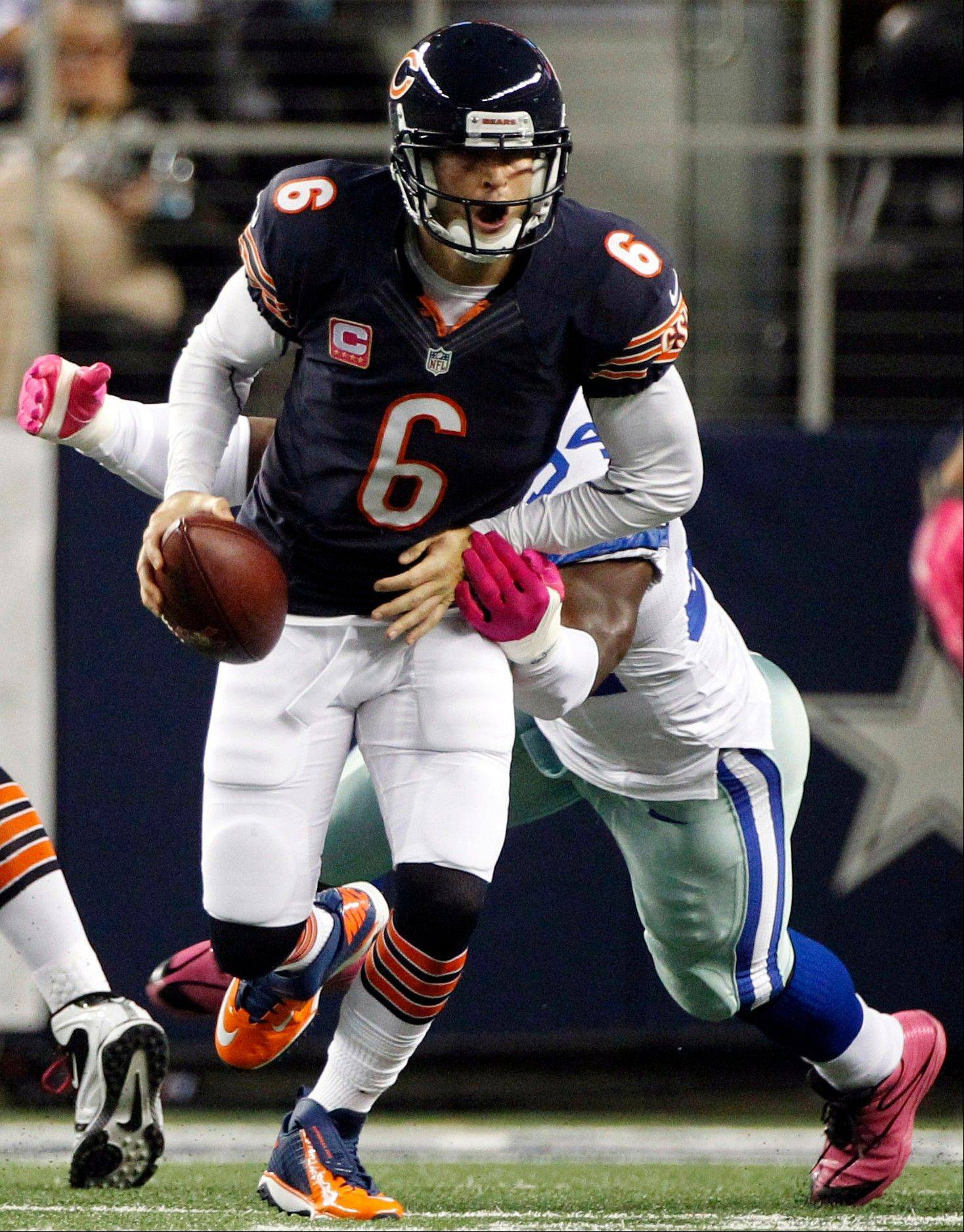 Dallas Cowboys outside linebacker DeMarcus Ware sacks Chicago Bears quarterback Jay Cutler during the first half.