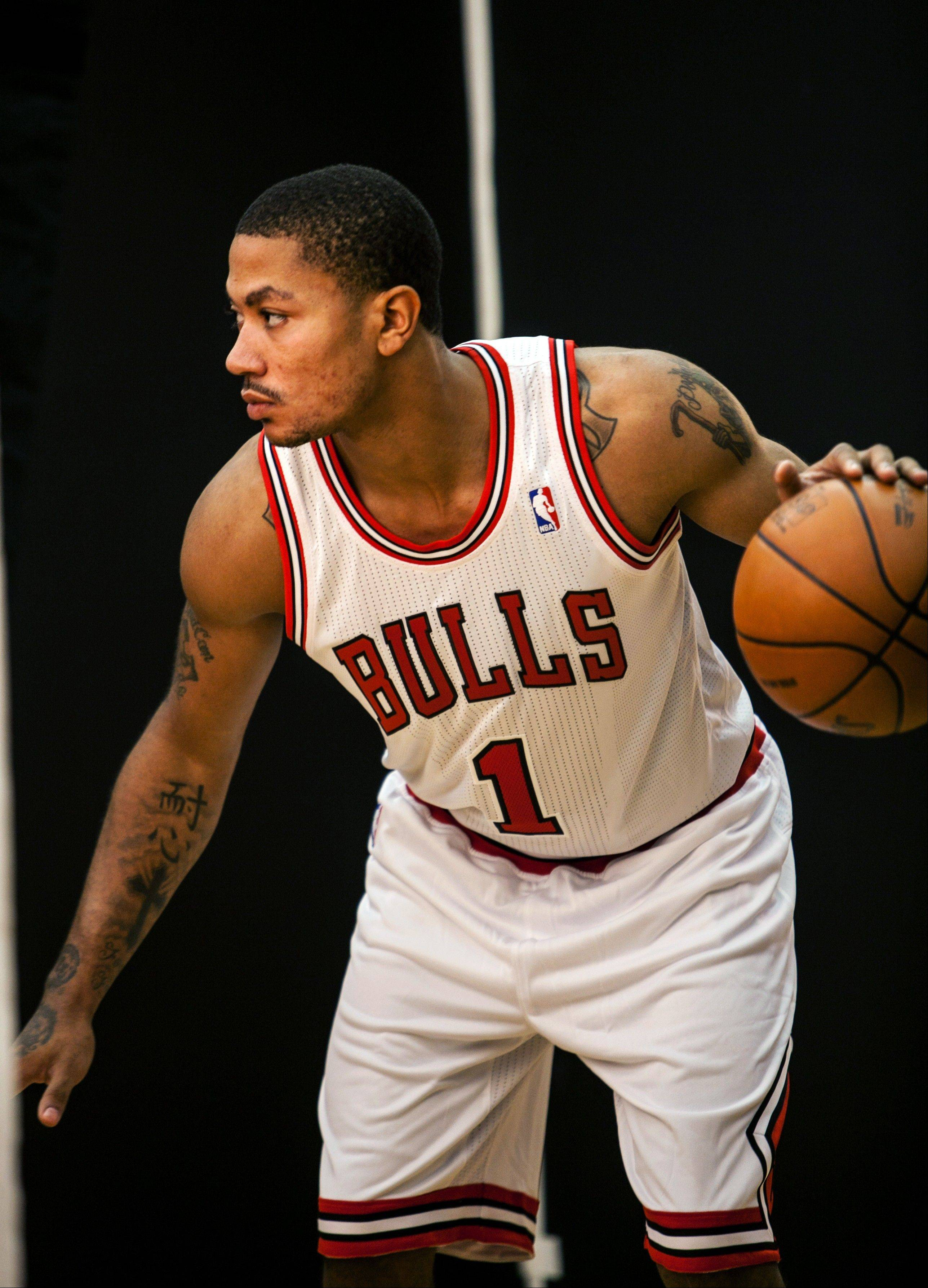 The Bulls' Derrick Rose poses for pictures during the NBA basketball team's media day Monday in Deerfield.
