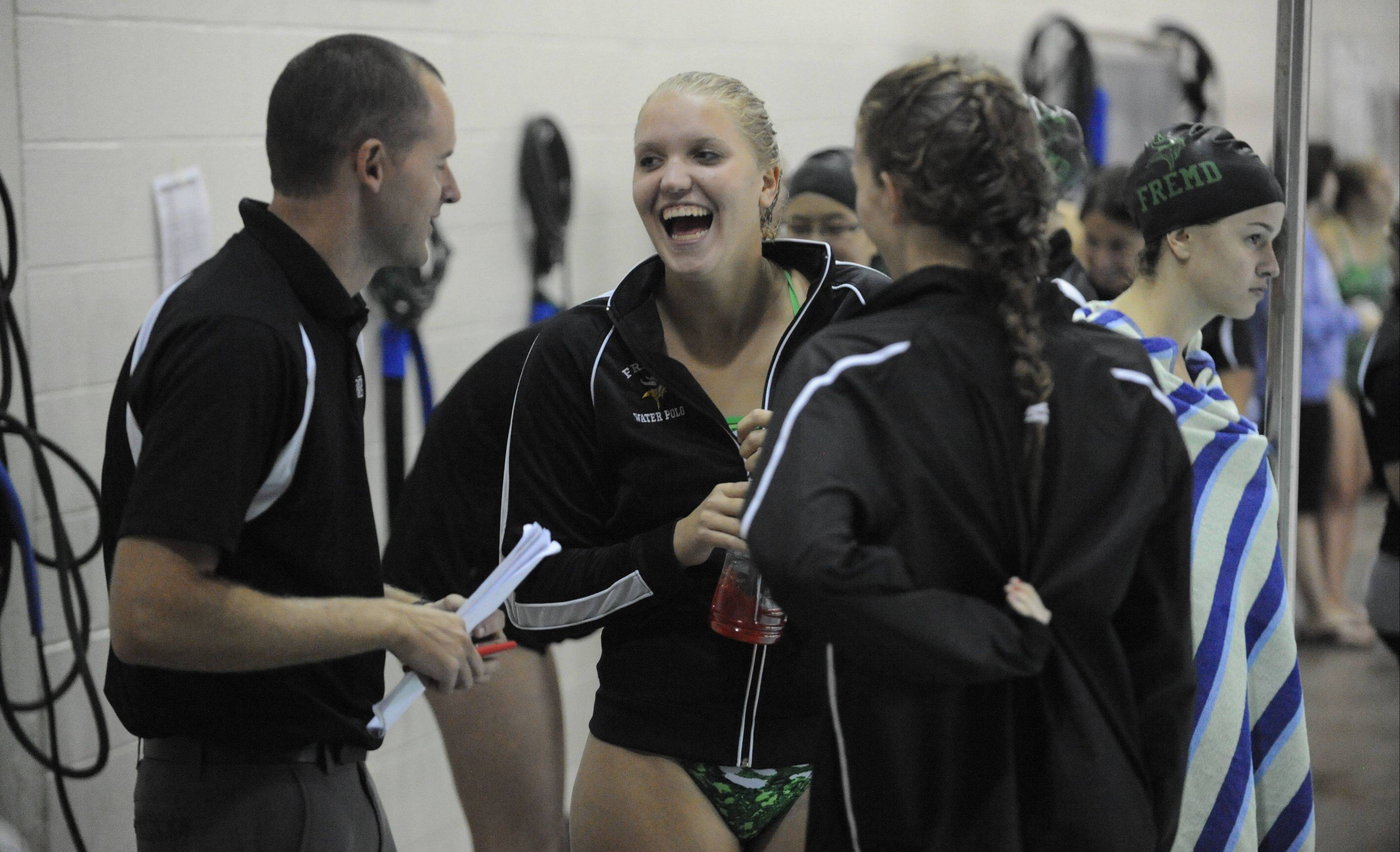 Senior Breanna Anderson talks with coach Andrew Kittrell on deck at Fremd.