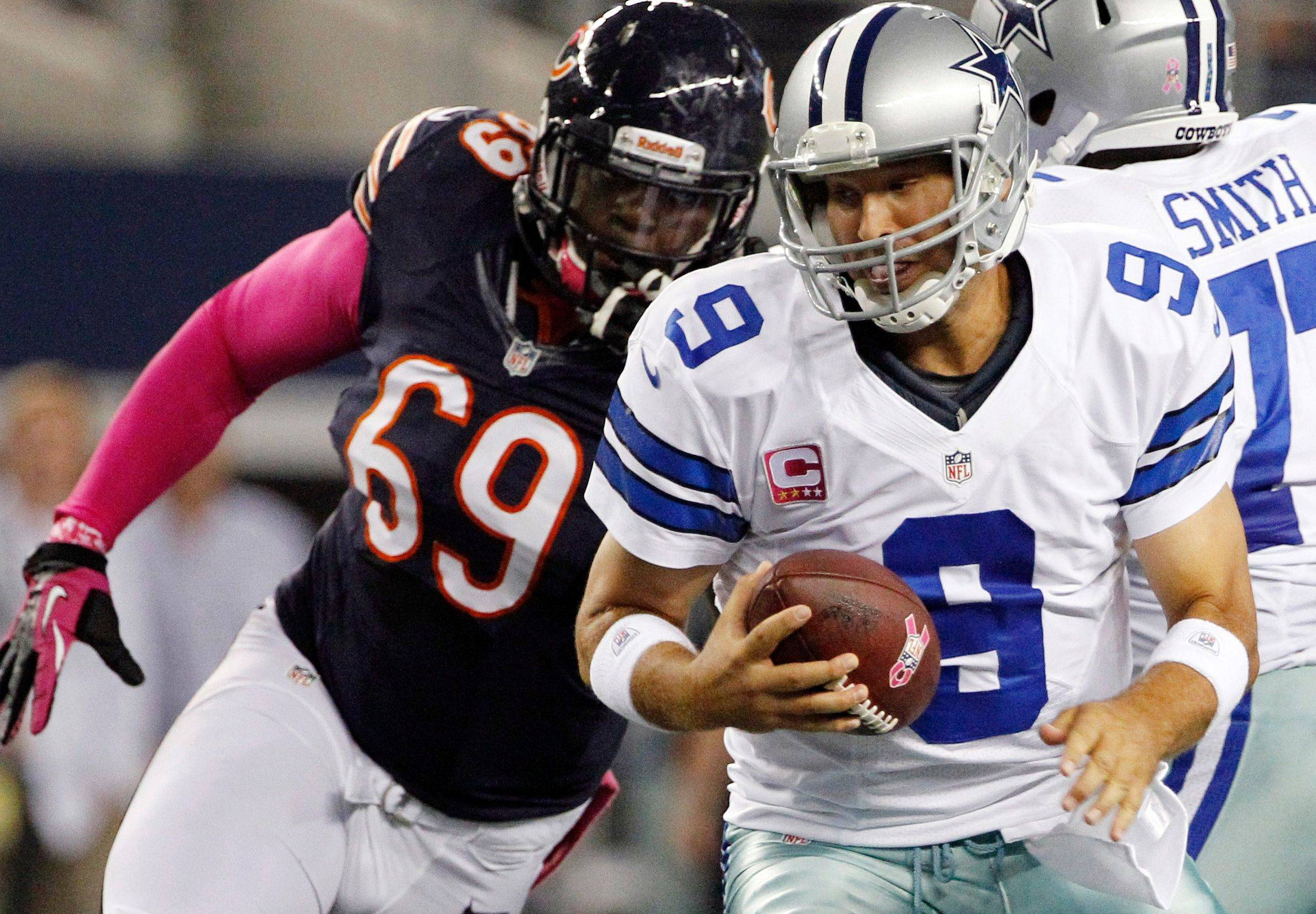 Henry Melton moves in to sack Tony Romo during the first half of the Bears' victory Monday. For Melton, it was his team-high fourth sack.