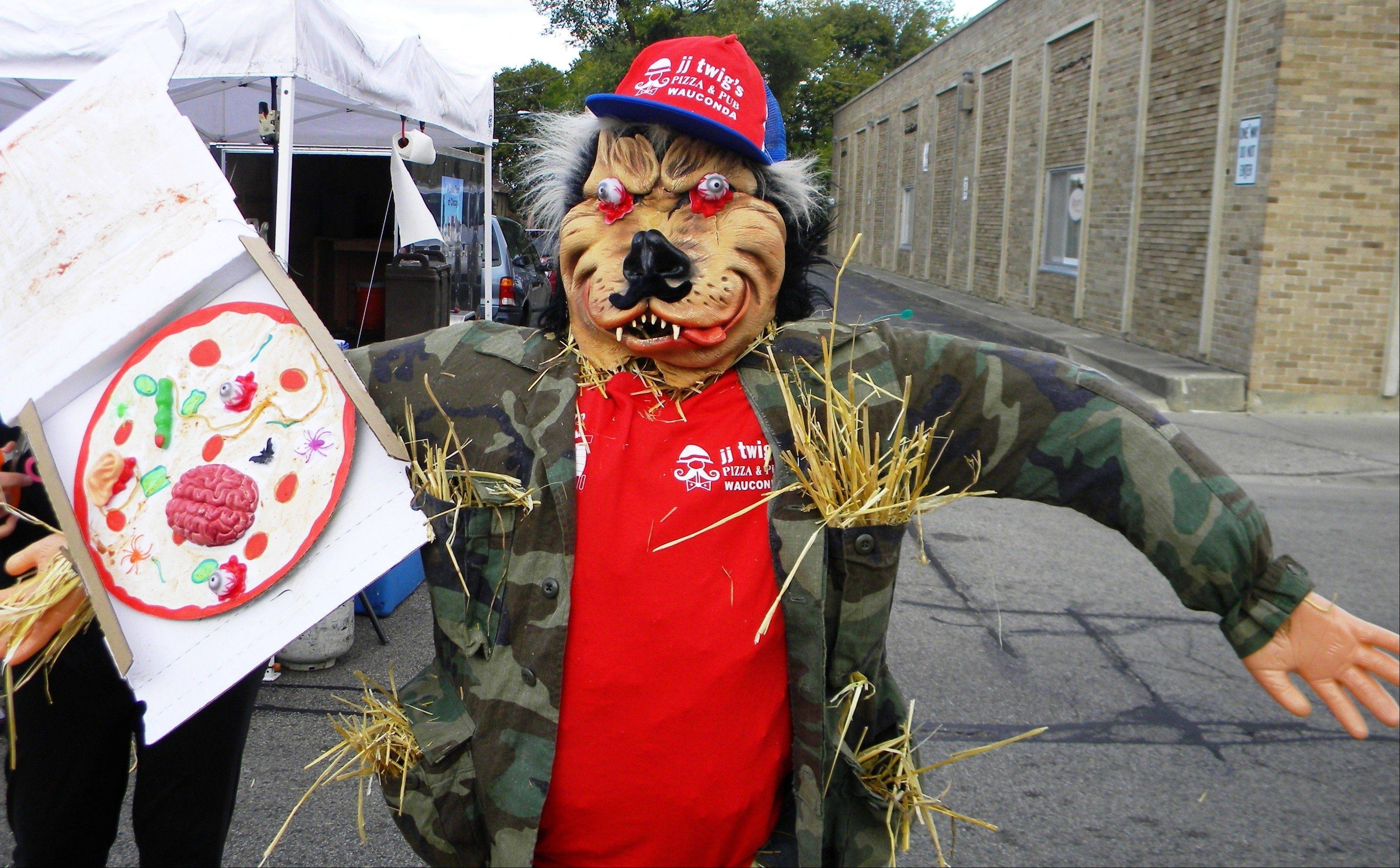 Scarecrows on Main third-place Winner, jj Twig's Pizza delivery man has a ghoulish menu.