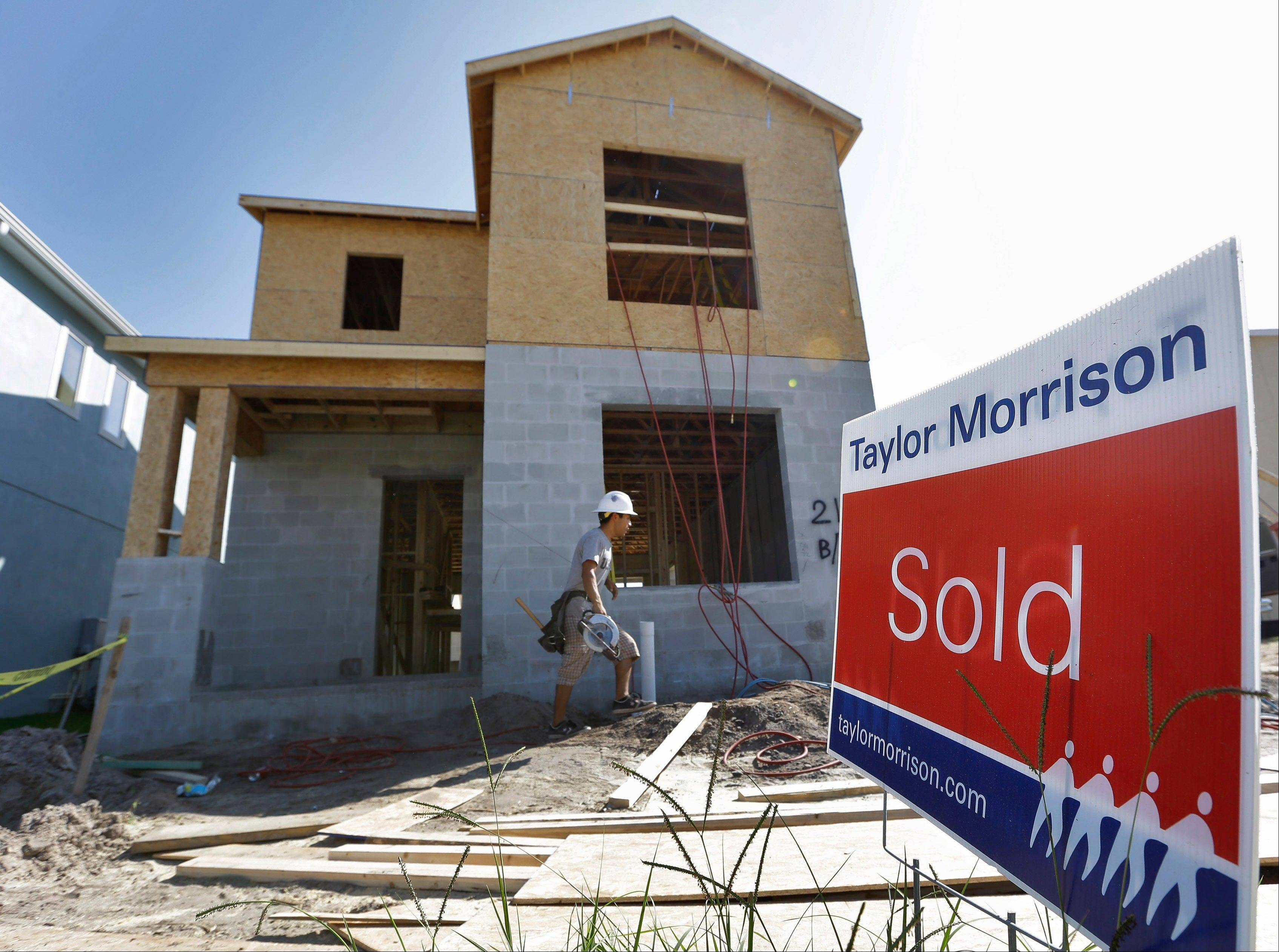 Associated Press/Sept. 26, 2012 A �sold� sign sits out in front of a home under construction at the Winthrop subdivision in Riverview, Fla.