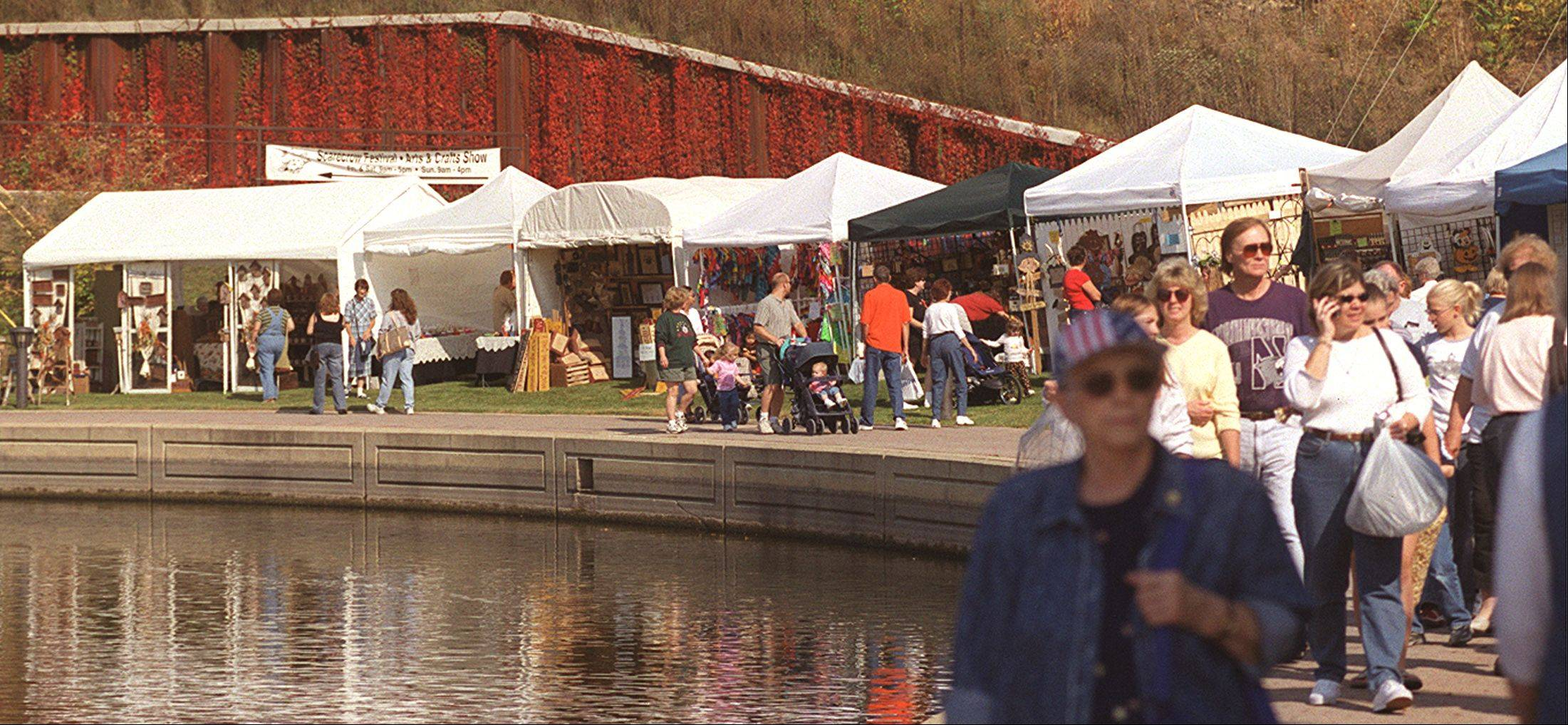 Shoppers pack the riverwalk along the Fox River in St. Charles for a previous Autumn on the Fox Art and Craft Show. This year�s show, part of St. Charles Scarecrow Fest, will be held from 9 a.m. to 5 p.m. Friday and Saturday and 9 a.m. to 4 p.m. Sunday in Pottawatomie Park.