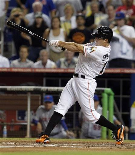 Adam Greenberg's second major league plate appearance went a lot better than the first one, even though he struck out. Returning to the big leagues seven years after he was beaned, Greenberg fanned on three pitches Tuesday night as a pinch-hitter for the Miami Marlins.