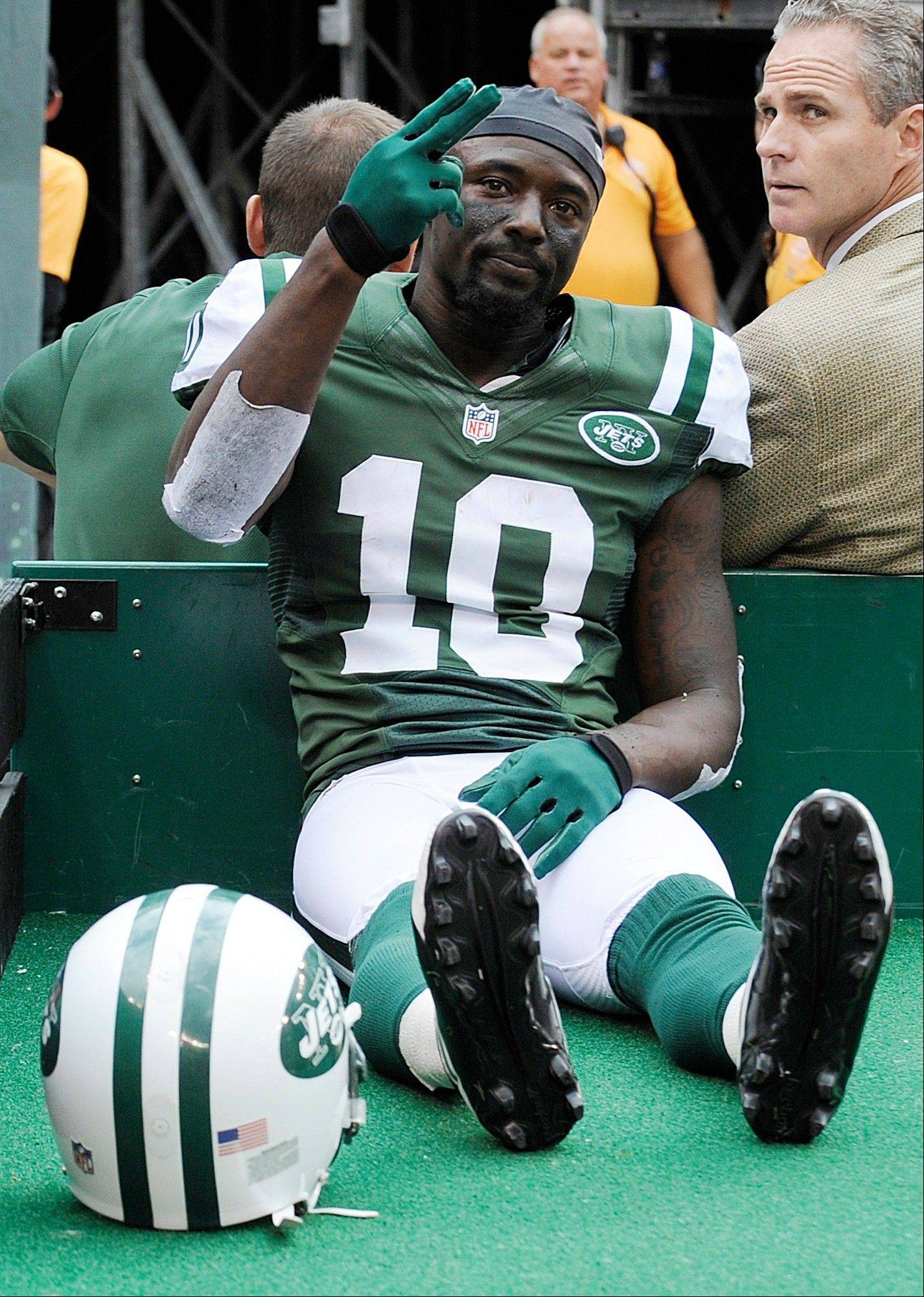 Injured New York Jets wide receiver Santonio Holmes gestures to fans as he is carted off the field during Sunday�s game against San Francisco in East Rutherford, N.J.