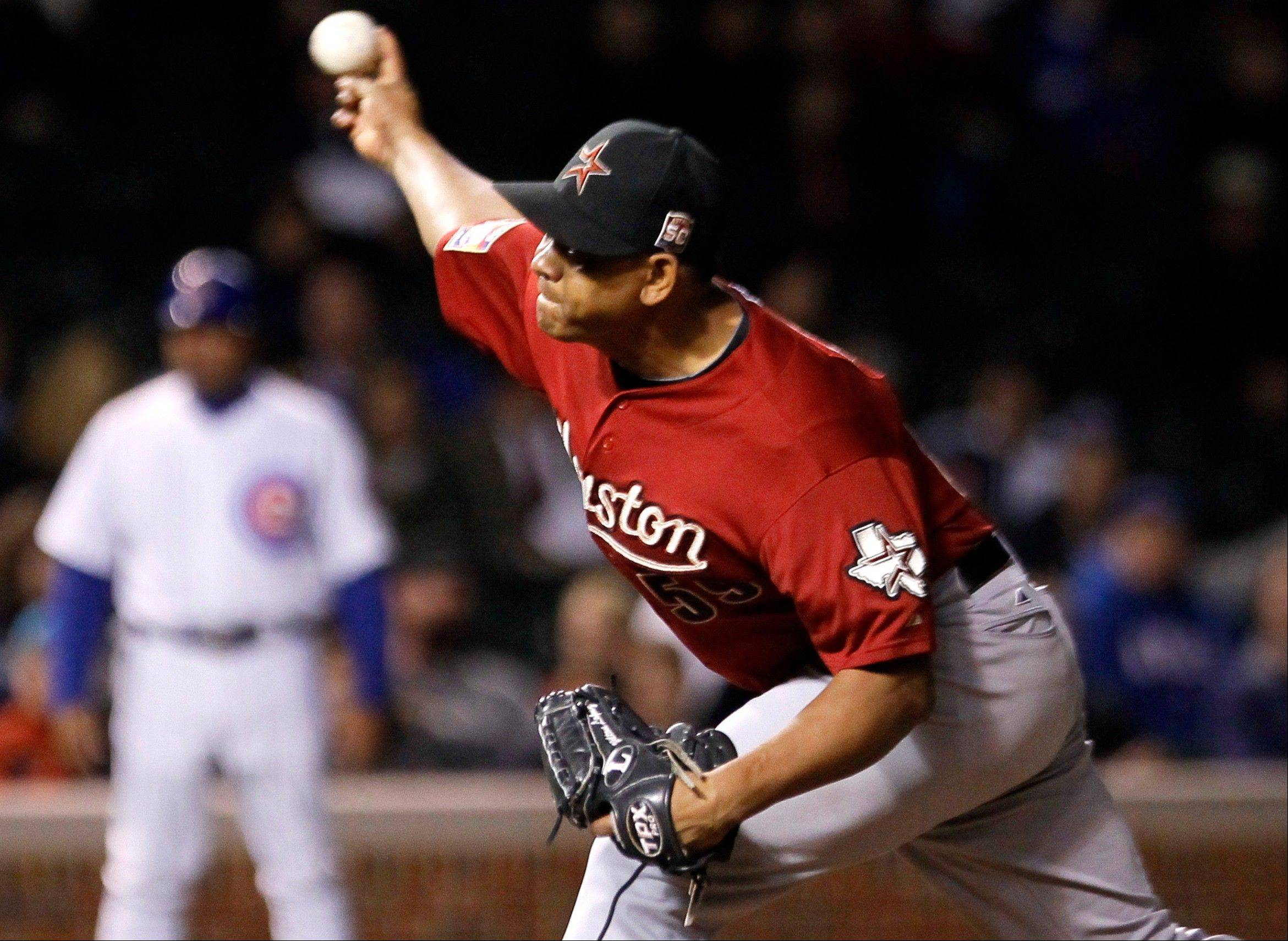 Houston Astros relief pitcher Wilton Lopez delivers during the ninth inning of a baseball game against the Chicago Cubs, Tuesday, Oct. 2, 2012, in Chicago. The Astros won 3-0. (AP Photo/Charles Rex Arbogast)