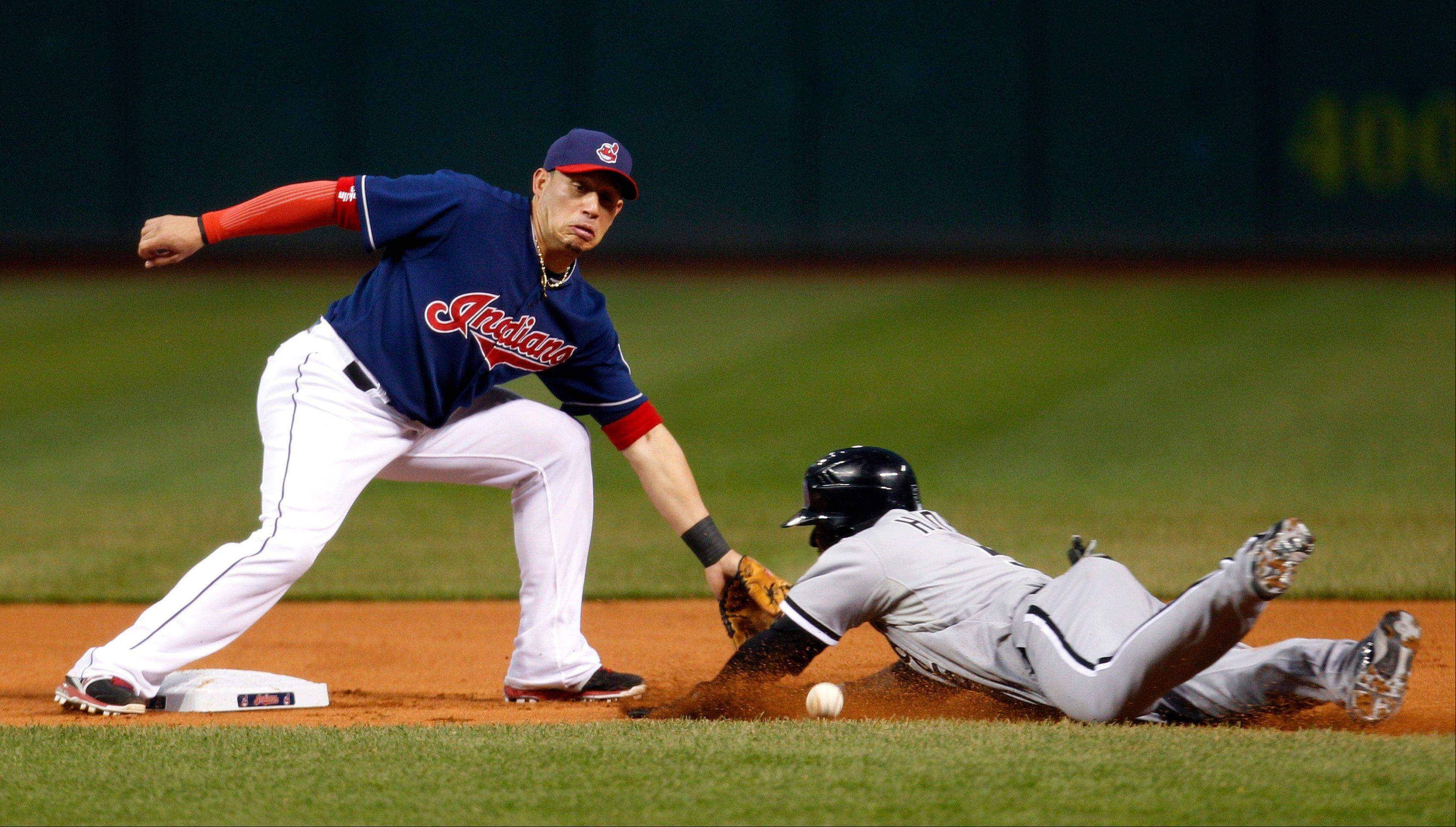Cleveland Indians shortstop Asdrubal Cabrera, left, waits for the ball as Chicago White Sox's Orlando Hudson slides safely into second base on a steal in the first inning of a baseball game, Tuesday, Oct. 2, 2012, in Cleveland. (AP Photo/Tony Dejak)