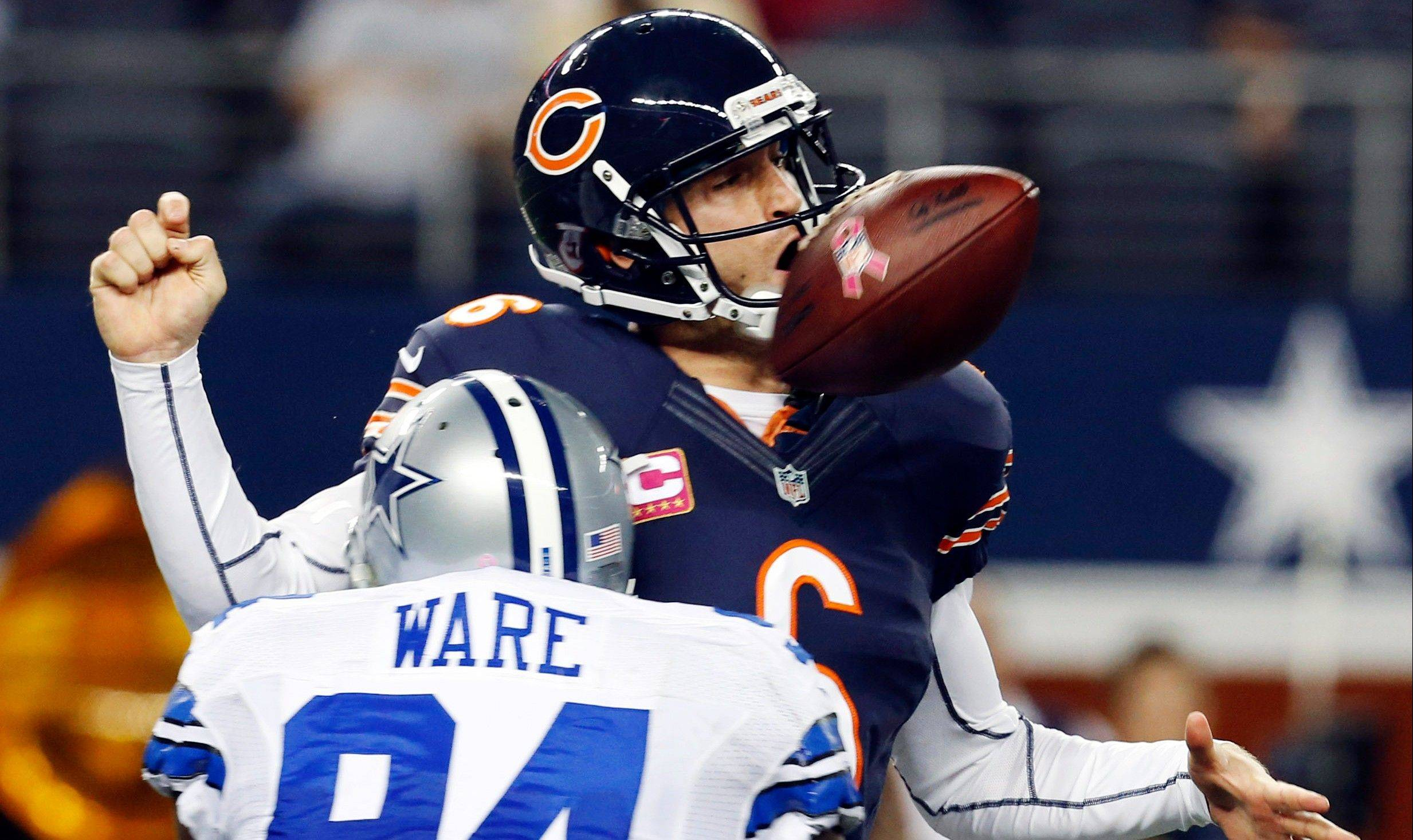 DeMarcus Ware of the Cowboys crashes into Bears quarterback Jay Cutler, who fumbles the ball in the second half Monday night. The Bears beat the host Cowboys 34-19.