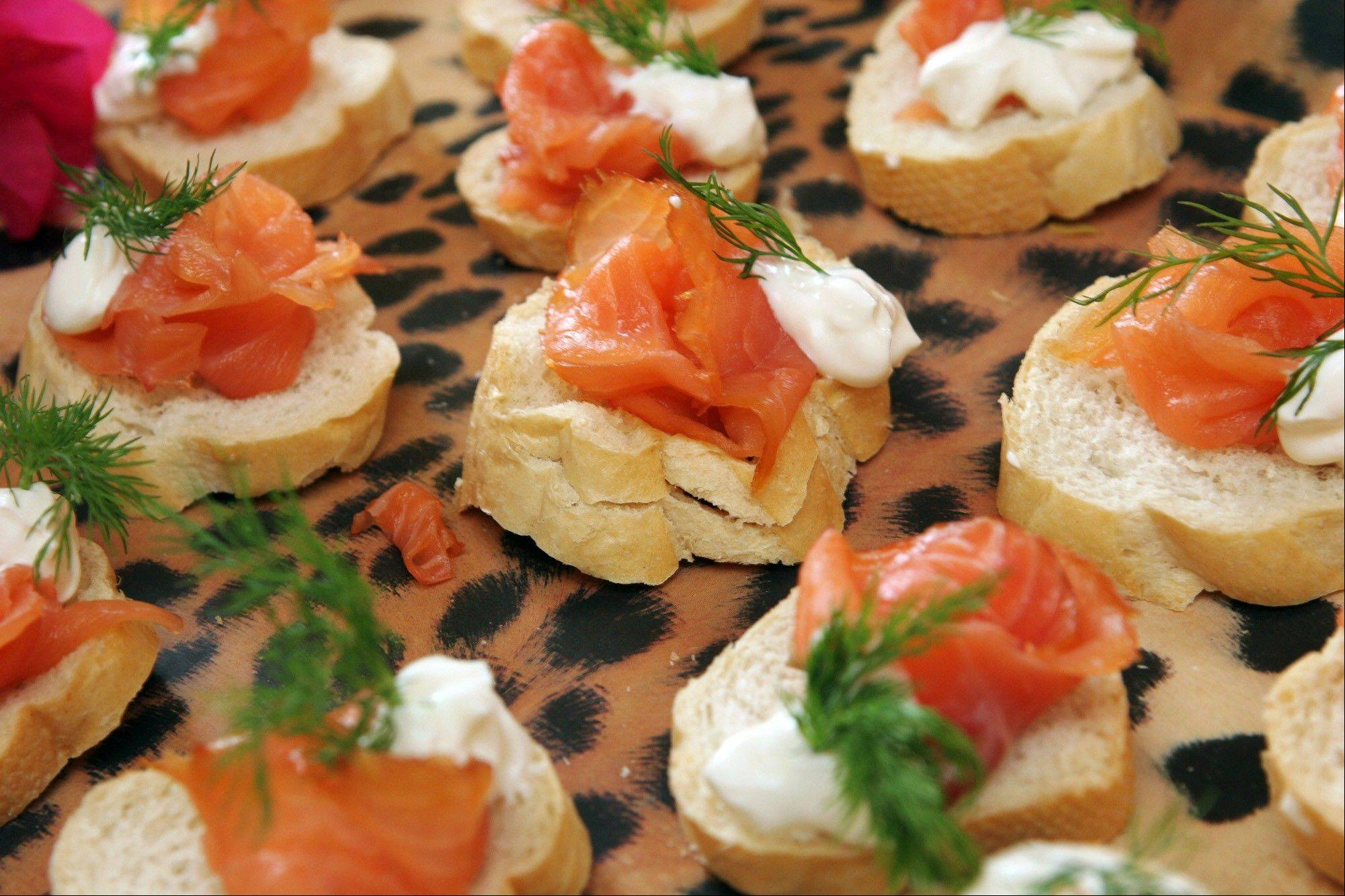 Smoked salmon on toasted rye rounds with dilled cream cheese and sour cream.