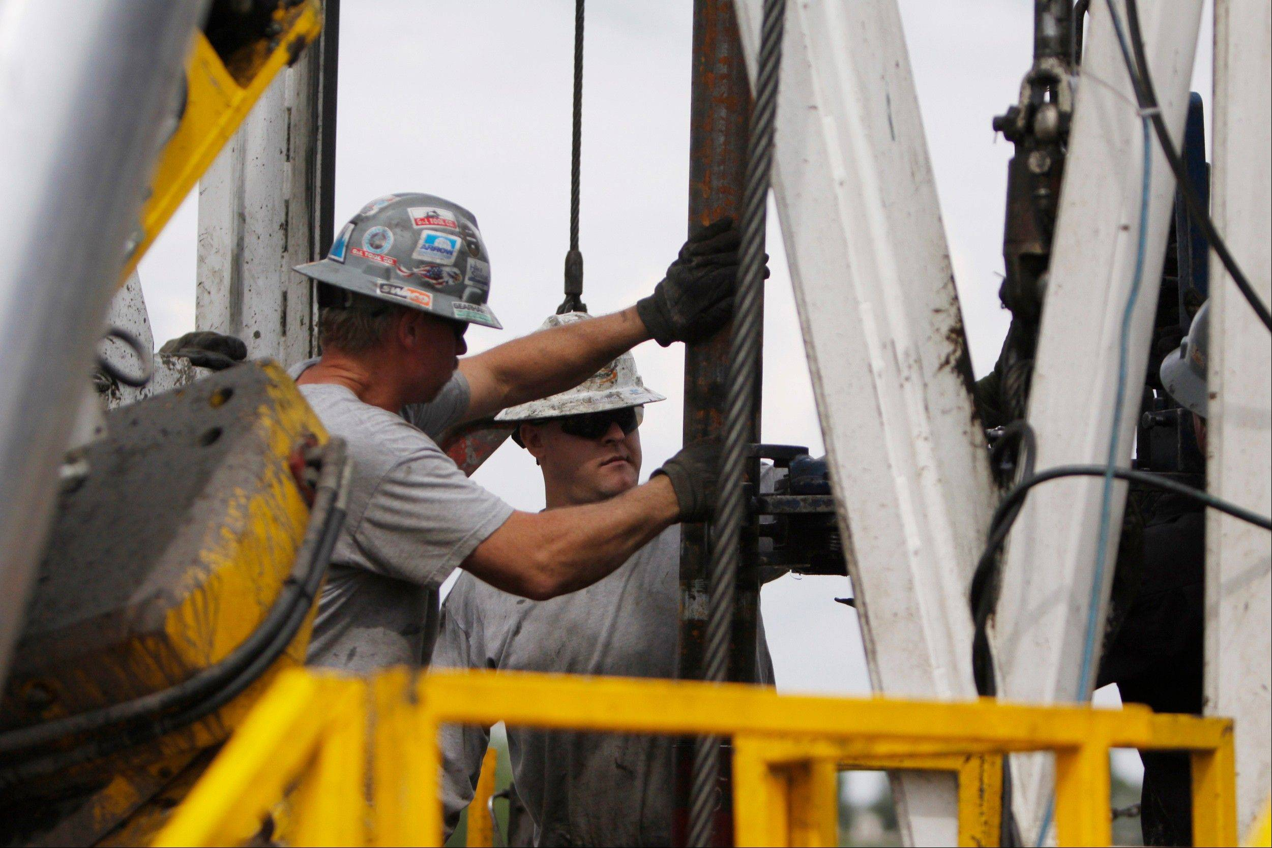 Associated Press/Aug. 25, 2009Crew members with Anadarko Petroleum Corp., work on a drilling platform on a Weld County farm near Mead, Colo. The drilling process called hydraulic fracturing, or fracking, is shaking up world energy markets from Washington to Moscow to Beijing. Some predict what was once unthinkable: that the U.S. won't need to import natural gas in the near future. But pollution concerns remain.