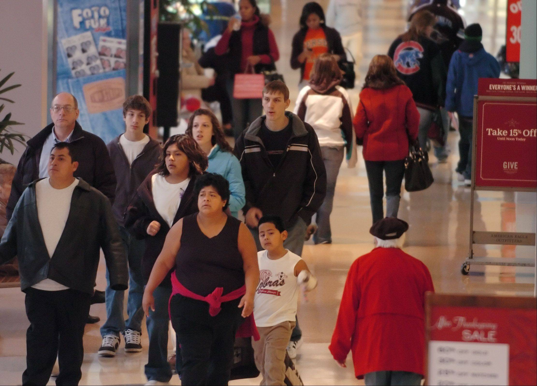 Americans are expected to spend more during what's traditionally the busiest shopping season of the year, but they're not exactly ready to shop `til they drop like they have been in the past two years.
