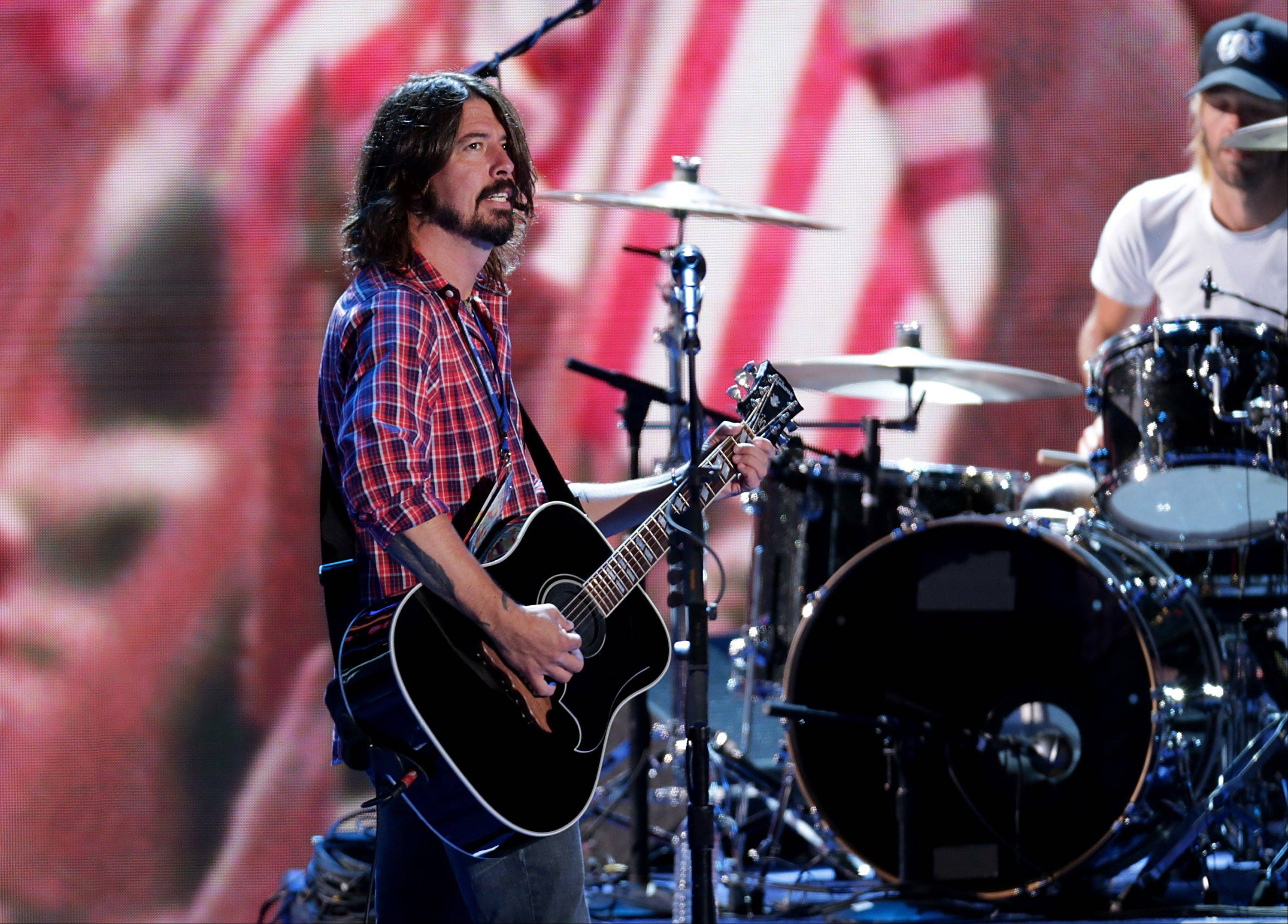 Dave Grohl, left, and Taylor Hawkins of the Foo Fighters are officially taking a break from playing as a band.