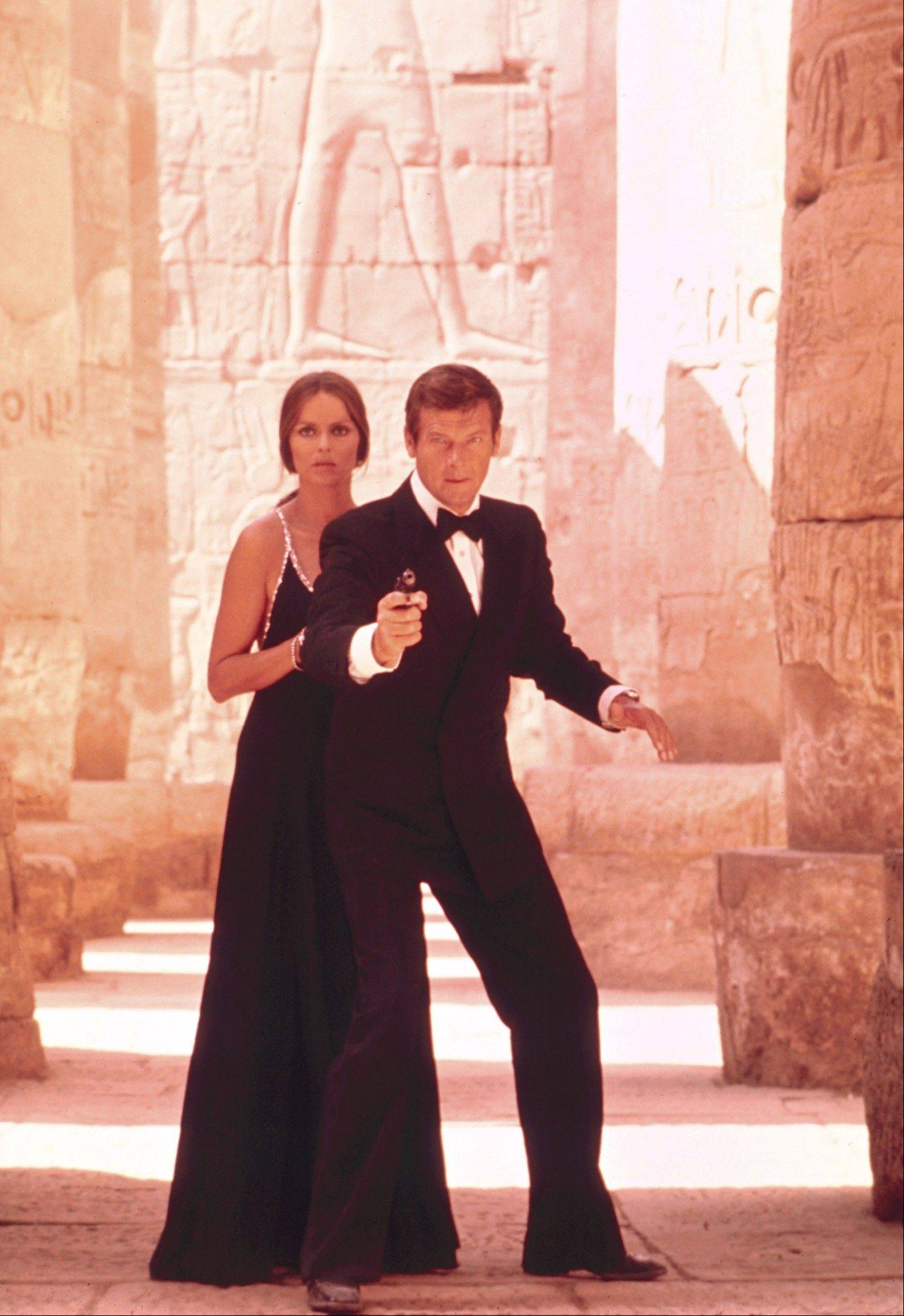 "Roger Moore, right, as James Bond, and Barbara Bach as Major Anya Amasova, in the 1977 film, ""The Spy Who Loved Me."" Moore, played Bond in seven films, more than any other actor."