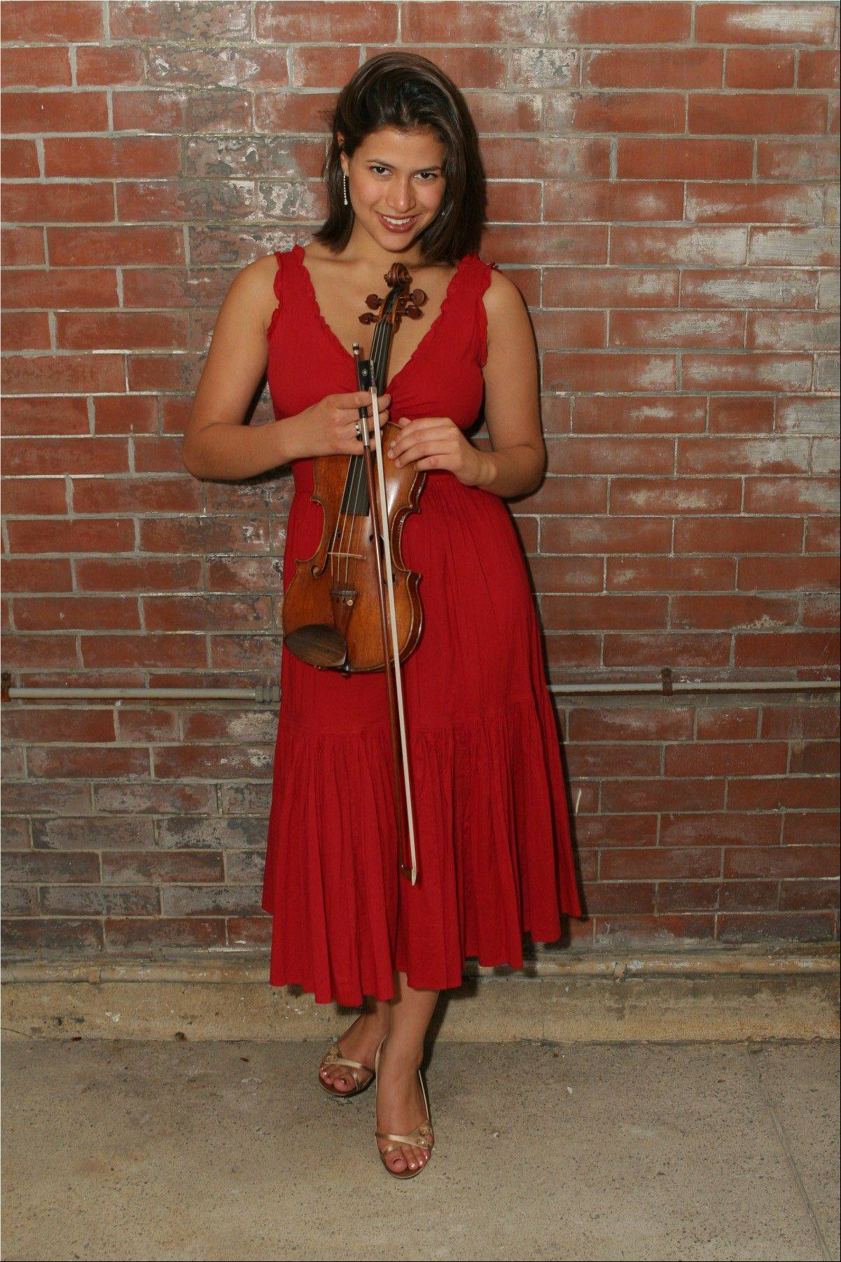 "Violinist Elena Urioste performs with the Elgin Symphony Orchestra in ""Night of Enchantment"" at the Hemmens Cultural Center in Elgin on Saturday and Sunday, Oct. 6-7."
