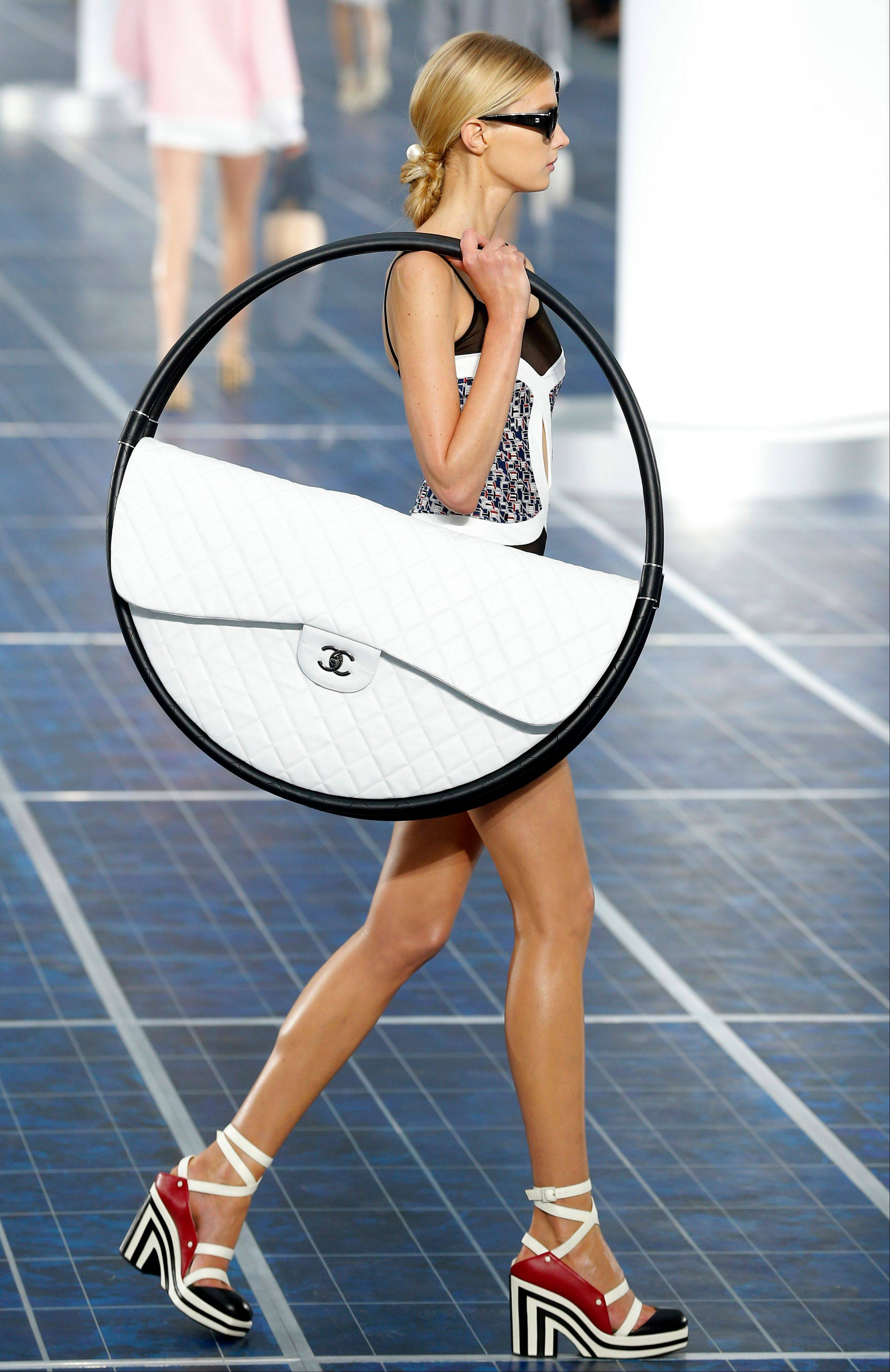 Associated Press A model wears a creation by German fashion designer Karl Lagerfeld for Chanel.