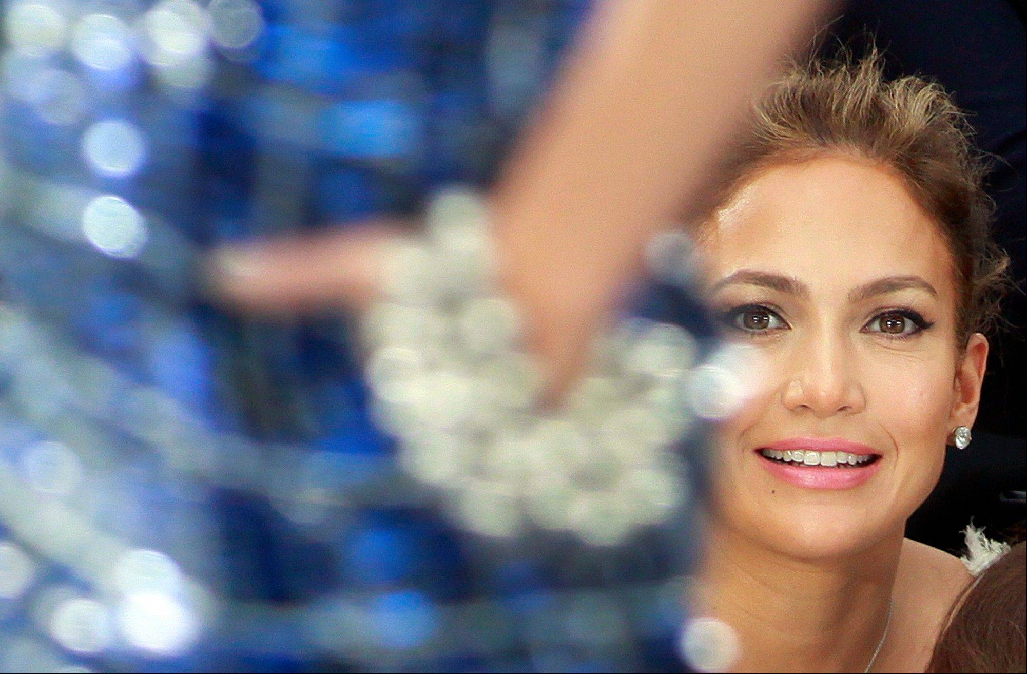 Associated Press Jennifer Lopez watches Chanel's ready to wear Spring-Summer 2013 collection.