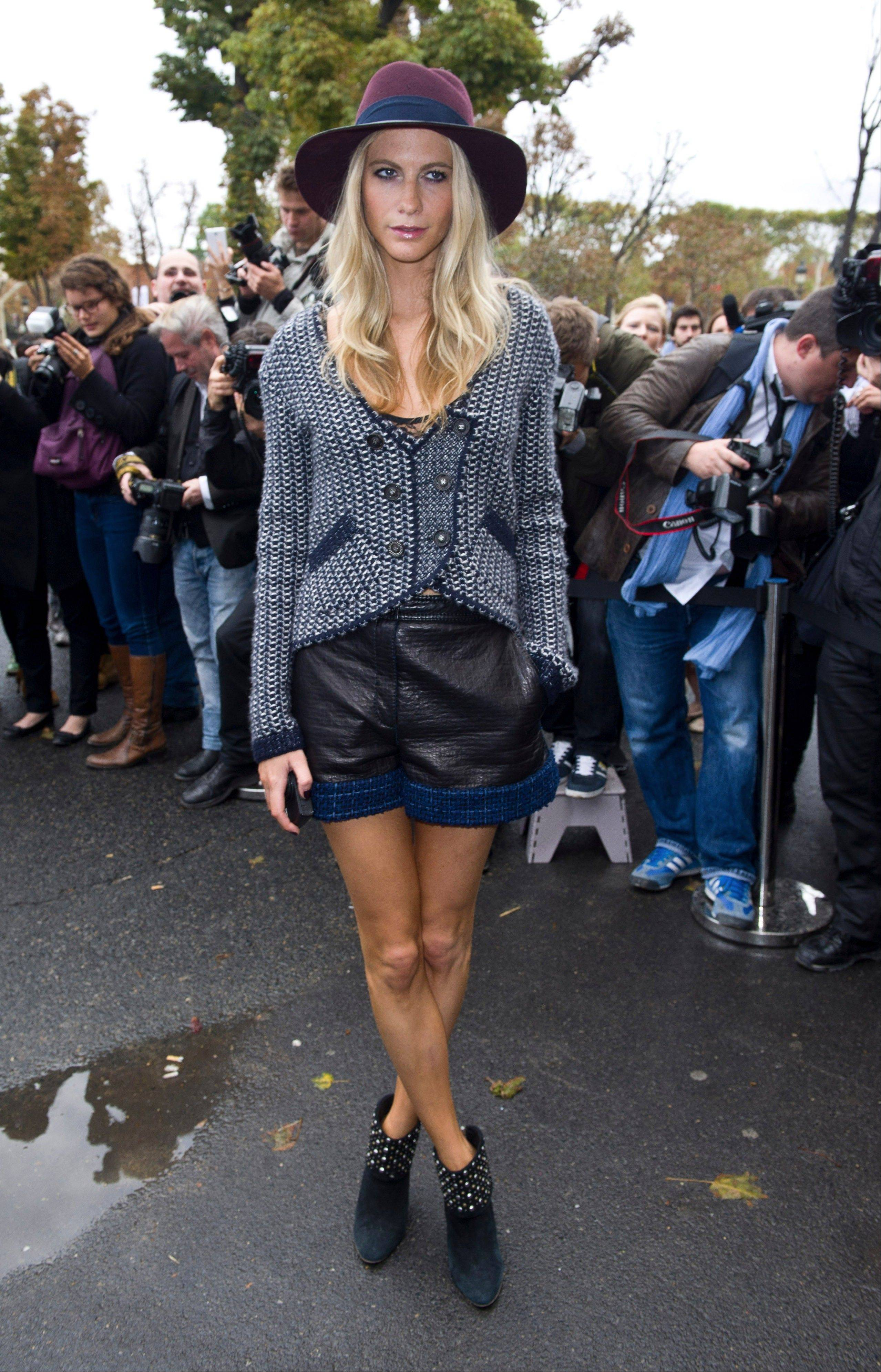 Associated Press British model and socialite Poppy Delevingne arrives Tuesday for the presentation of Chanel's ready to wear Spring-Summer 2013 collection.