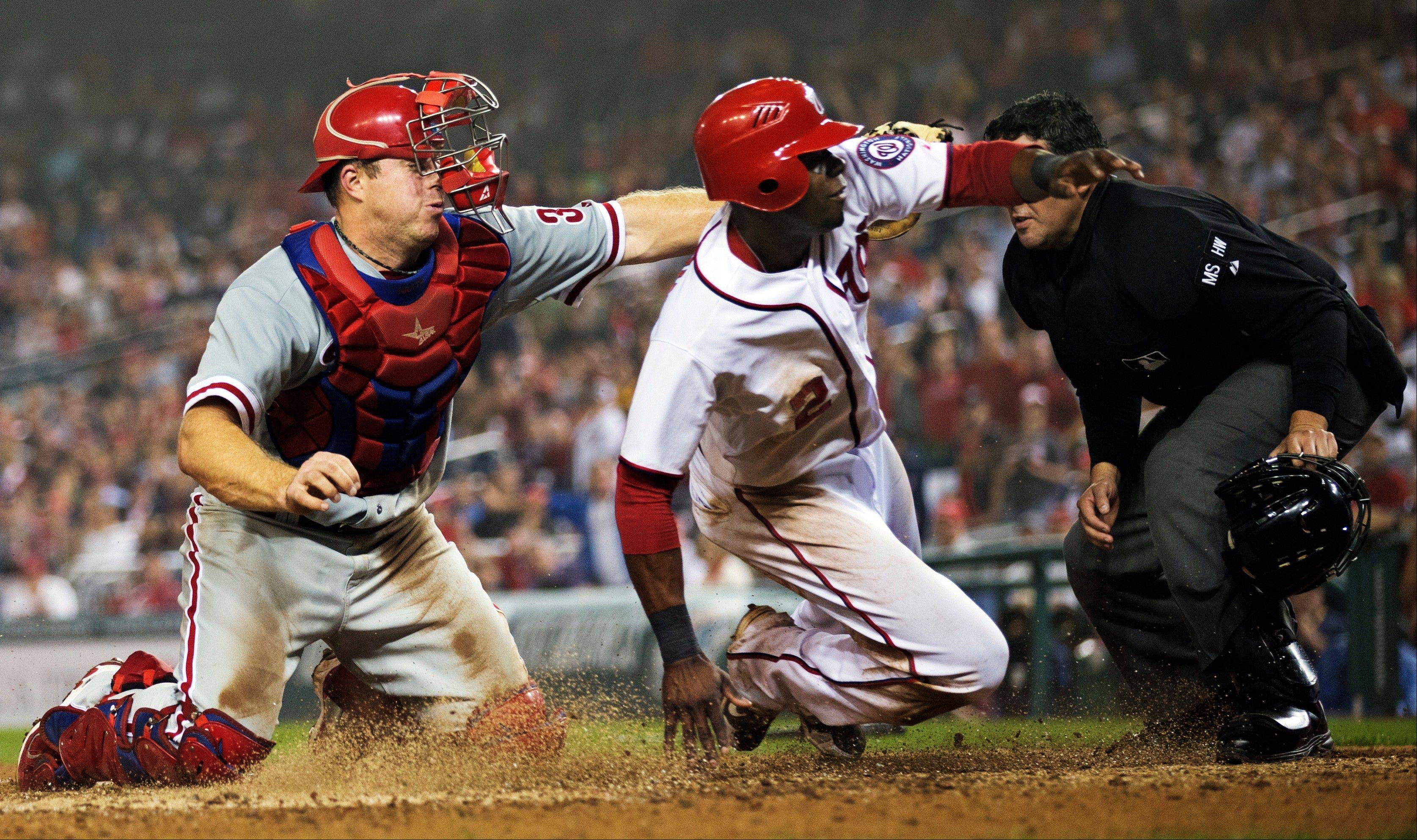 The Nationals' Roger Bernadina beats the tag of Philadelphia catcher Erik Kratz during the eighth inning Tuesday in Washington.