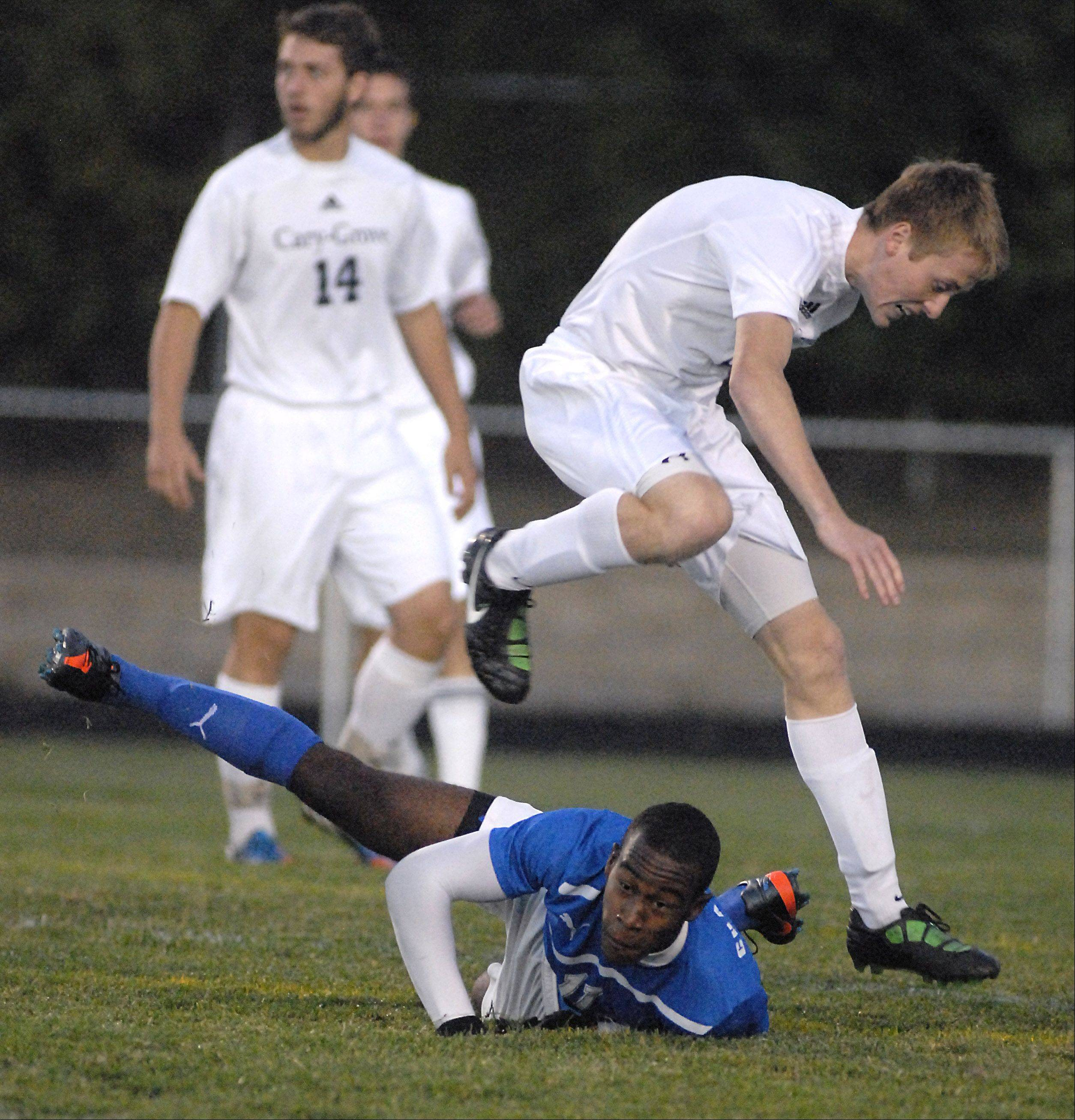 Cary-Grove's Brian O'Connor leaps over Dundee-Crown's Malik Washington to avoid a collision in the first half on Tuesday, October 2.